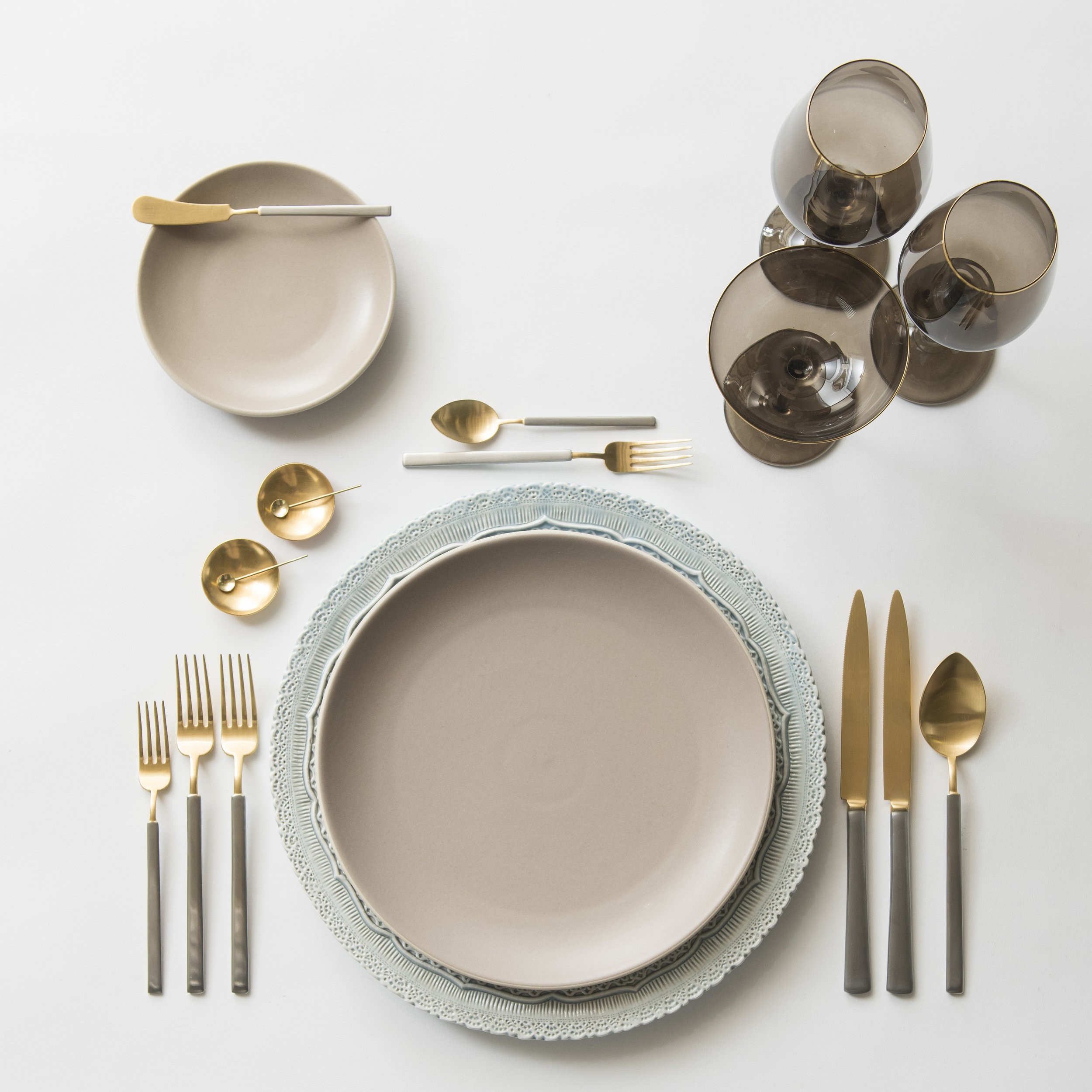 RENT: Lace Chargers in Dusty Blue + Heath Ceramics in French Grey + Axel Flatware in Matte 24k Gold/Silver + Bella 24k Gold Rimmed Stemware in Smoke + 14k Gold Salt Cellars + Tiny Gold Spoons  SHOP:Bella 24k Gold Rimmed Stemware in Smoke + 14k Gold Salt Cellars + Tiny Gold Spoons