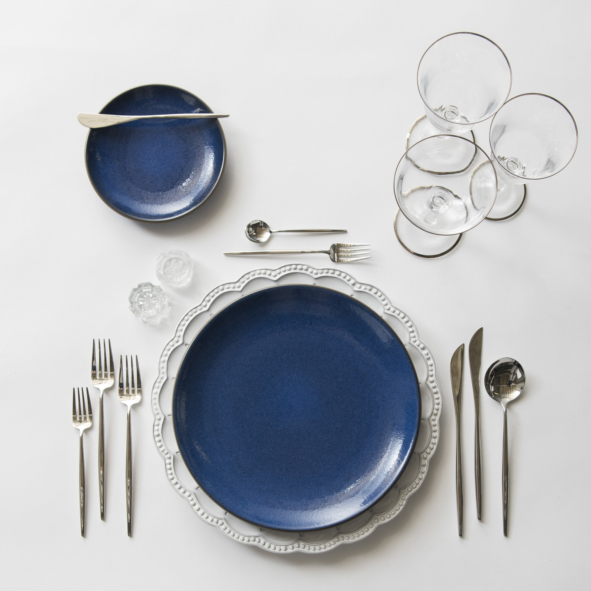 RENT: Signature Collection Chargers + Heath Ceramics in Moonstone + Moon Flatware in Polished Steel + Chloe Platinum Rimmed Stemware + Antique Crystal Salt Cellars  SHOP:Moon Flatware in Polished Steel + Chloe Platinum Rimmed Stemware