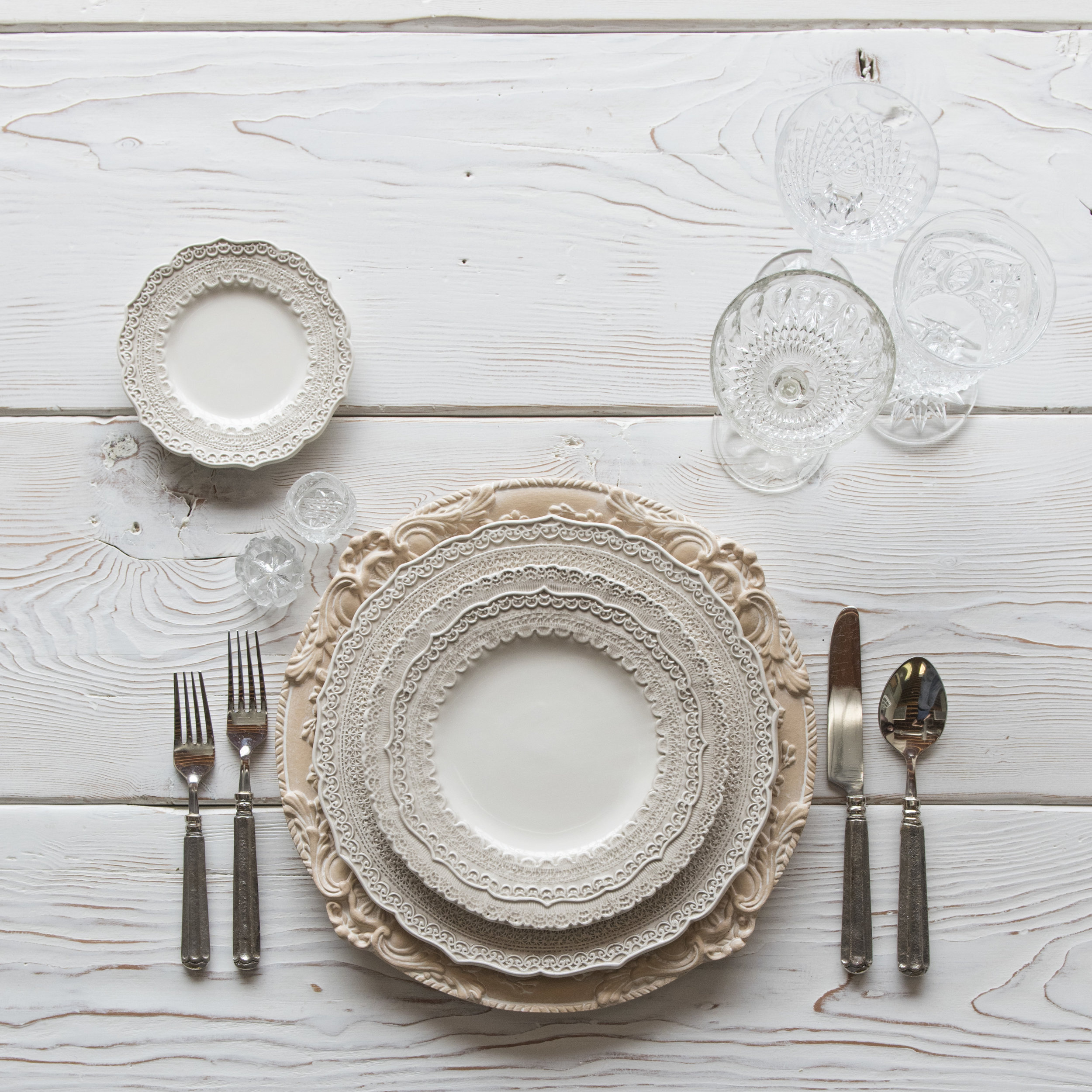RENT: Verona Chargers in Terracotta + Lace Dinnerware in White + Tuscan Flatware in Pewter + Vintage Cut Crystal Goblets + Early American Pressed Glass Goblets + Antique Crystal Salt Cellars  SHOP:Verona Chargers in Terracotta