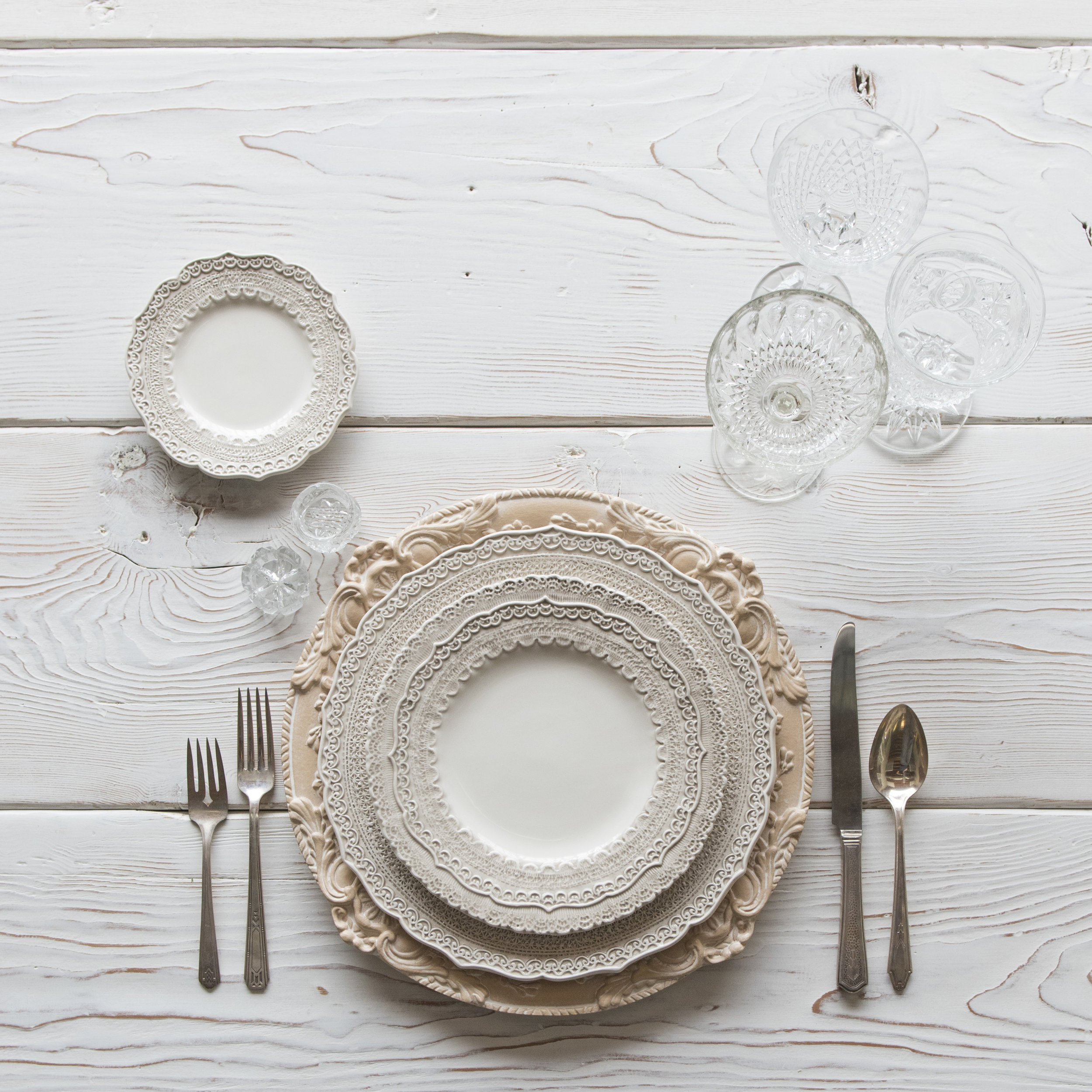 RENT: Verona Chargers in Terracotta + Lace Dinnerware in White + Deco Flatware + Vintage Cut Crystal Goblets + Early American Pressed Glass Goblets + Antique Crystal Salt Cellars  SHOP: Verona Chargers in Terracotta