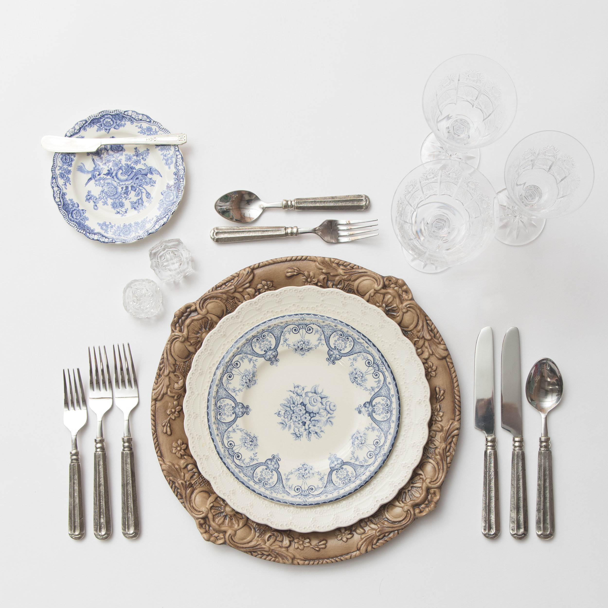 RENT: Verona Chargers in Walnut + White Collection Vintage China + Blue Garden Collection Vintage China + Tuscan Flatware in Pewter + Czech Crystal Stemware + Antique Crystal Salt Cellars  SHOP: Verona Chargers in Walnut