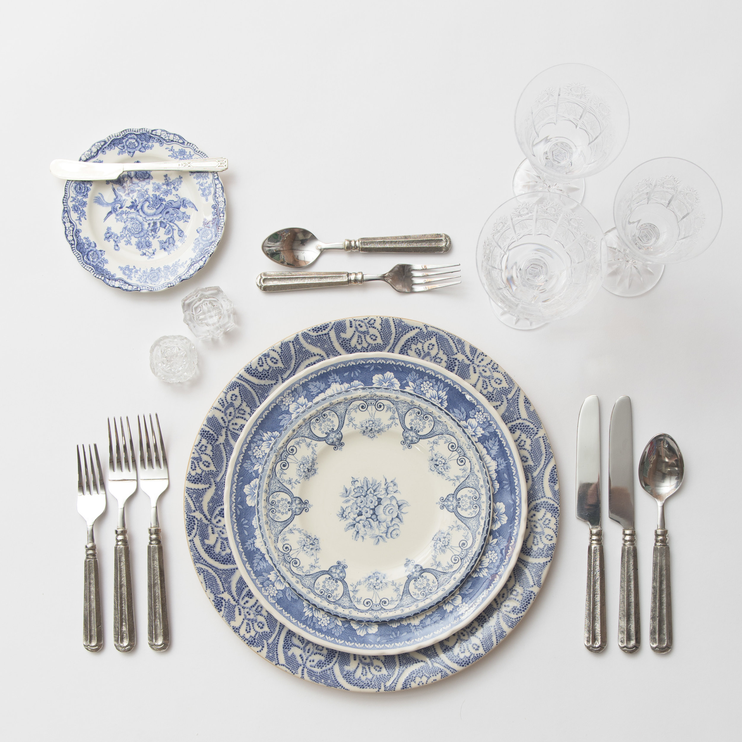 RENT: Blue Fleur de Lis Chargers + Blue Garden Collection Vintage China + Tuscan Flatware in Pewter + Czech Crystal Stemware + Antique Crystal Salt Cellars