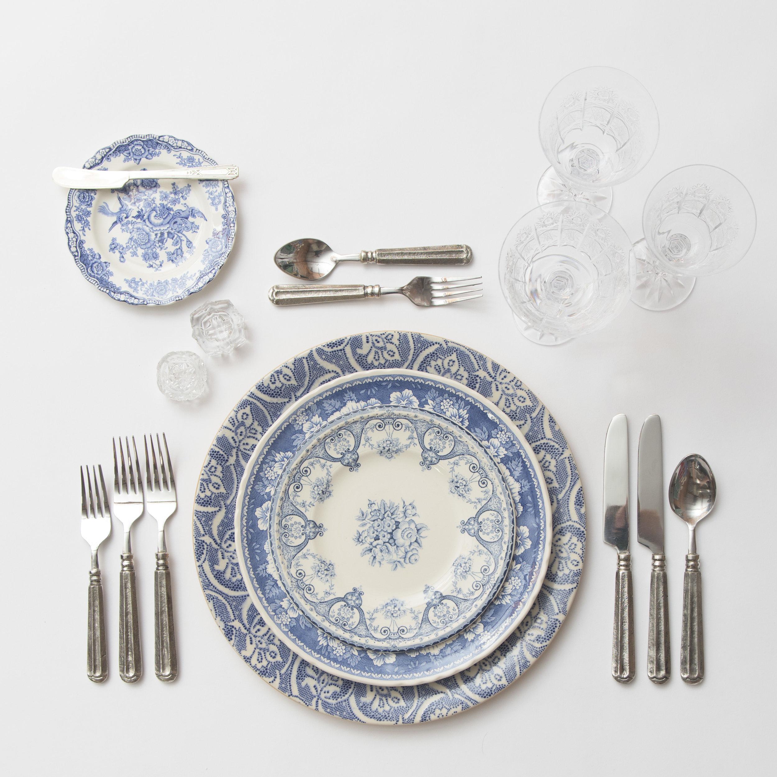 RENT: Blue Fleur de Lis Chargers +Blue Garden Collection Vintage China + Tuscan Flatware in Pewter + Czech Crystal Stemware + Antique Crystal Salt Cellars