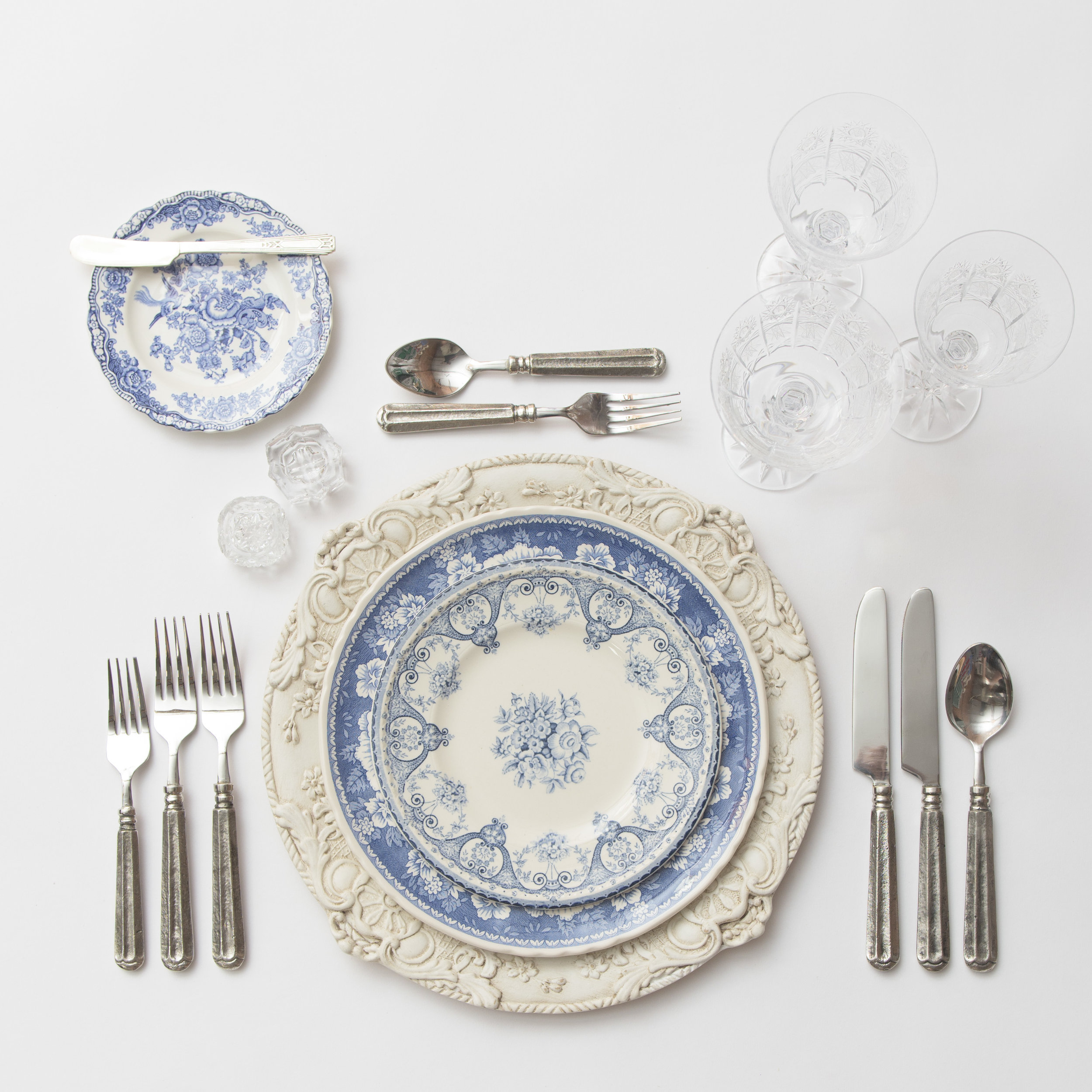 RENT: Verona Chargers in Antique White + Blue Garden Collection Vintage China + Tuscan Flatware in Pewter + Czech Crystal Stemware + Antique Crystal Salt Cellars  SHOP: Verona Chargers in Antique White