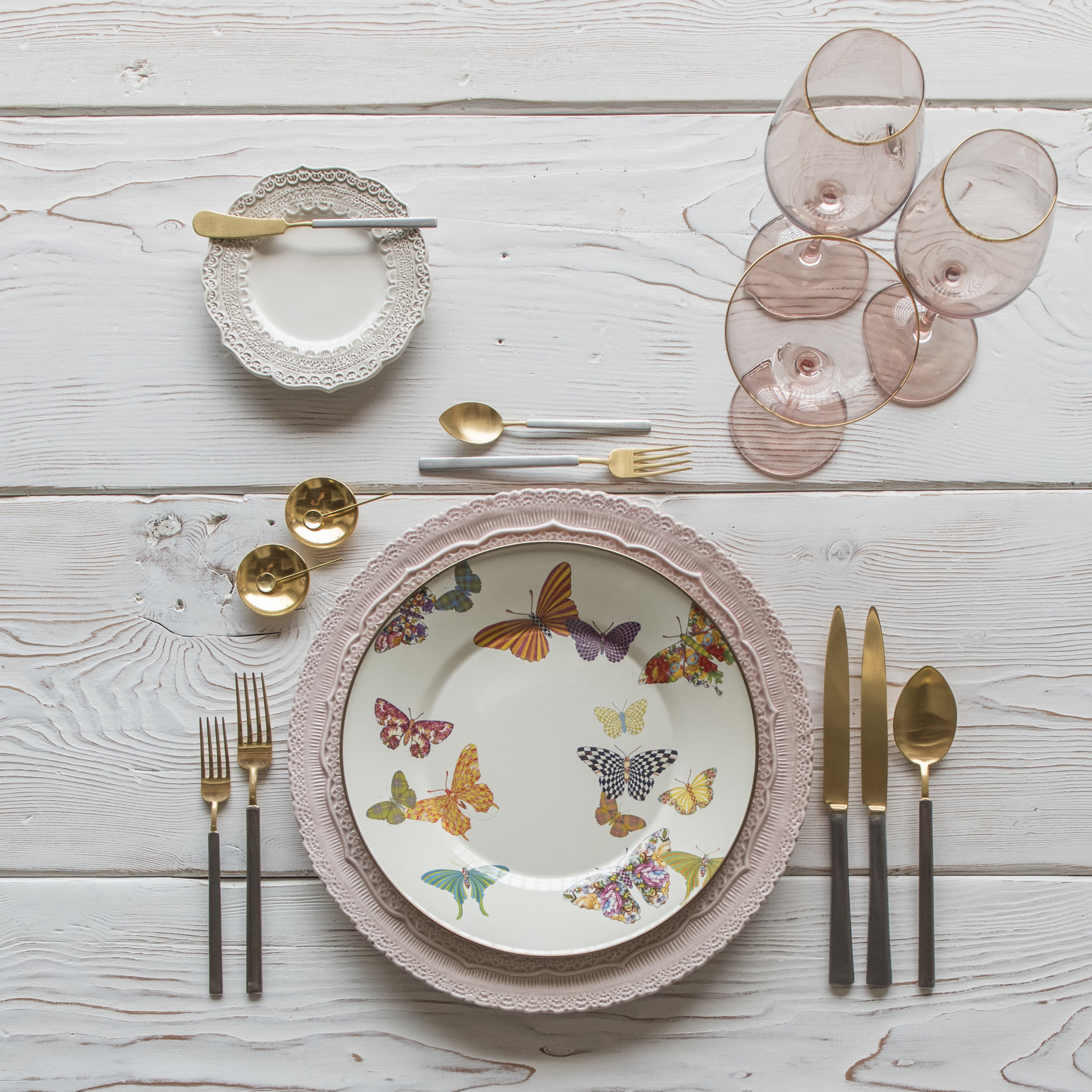 RENT: Lace Chargers in Blush + Lace Dinnerware in White + MacKenzie-Childs Butterfly Garden Collection + Axel Flatware in Matte 24k Gold/Silver + Bella 24k Gold Rimmed Stemware in Blush + 14k Gold Salt Cellars + Tiny Gold Spoons  SHOP:Bella 24k Gold Rimmed Stemware in Blush + 14k Gold Salt Cellars + Tiny Gold Spoons