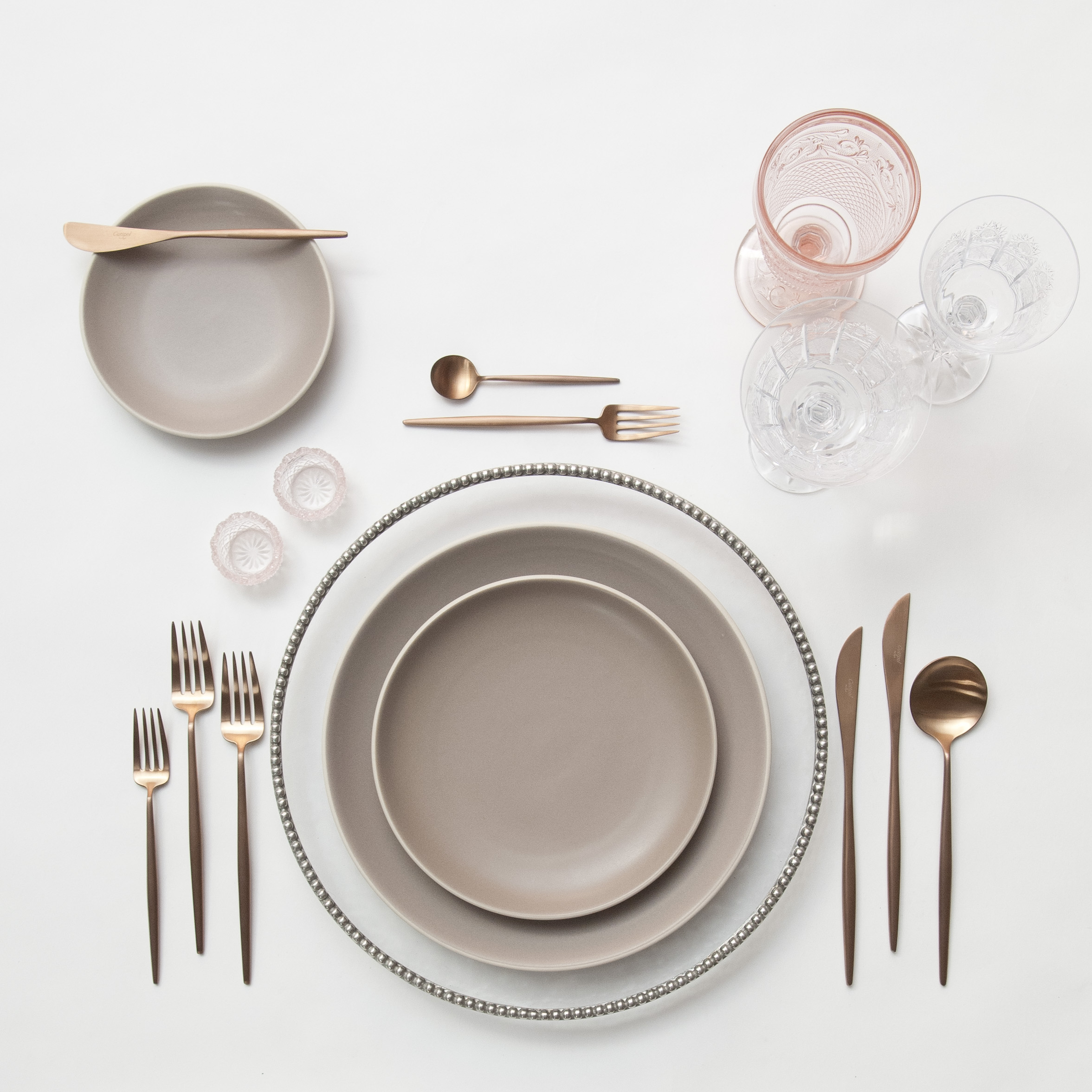 RENT: Pav é Glass  Chargers in Pewter + Heath Ceramics in French Grey + Moon Flatware in Brushed Rose Gold + Pink Vintage Goblets + Czech Crystal Stemware + Pink Crystal Salt Cellars   SHOP: Moon Flatware in Brushed Rose Gold