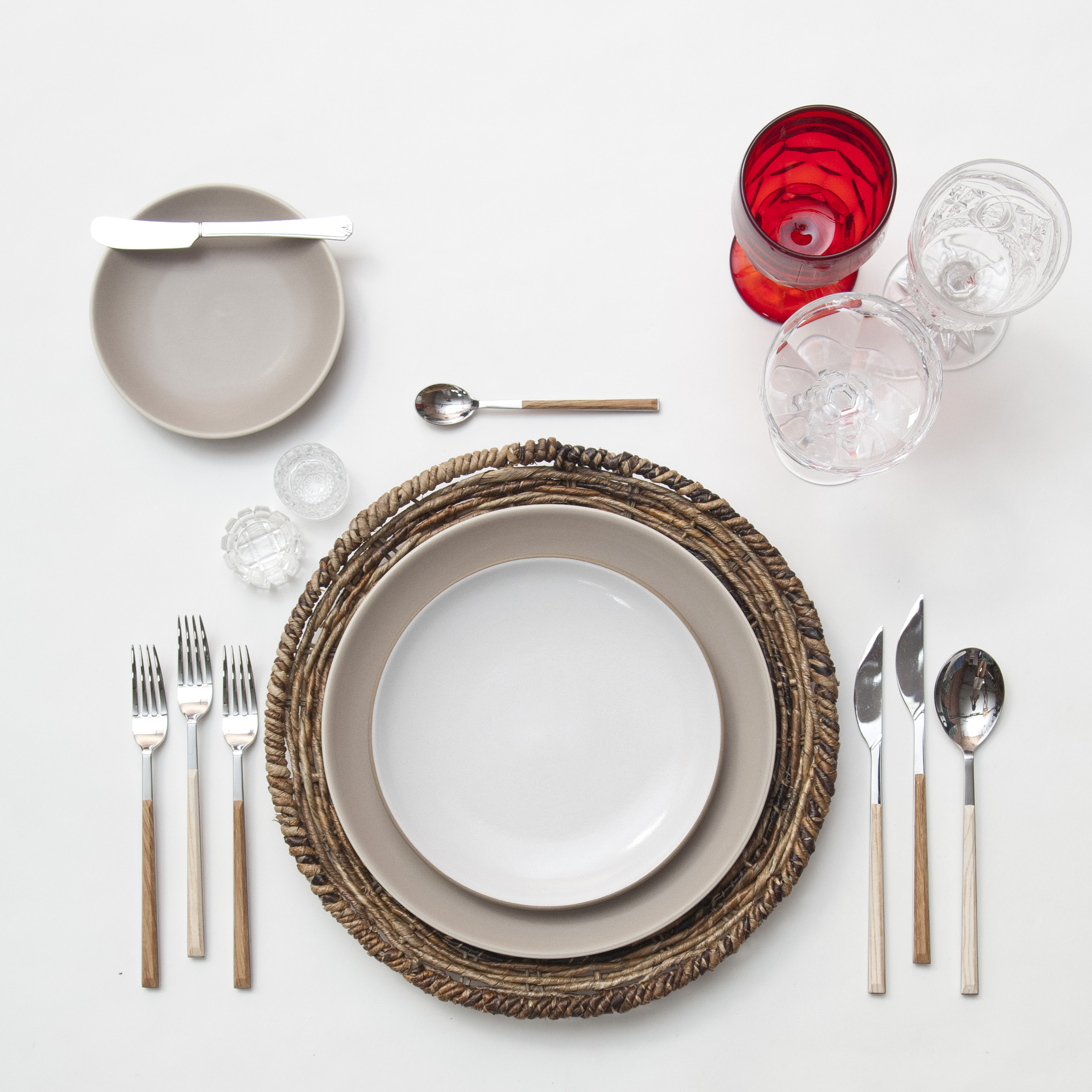 RENT: Natural Woven Chargers + Heath Ceramics in French Grey/Opaque White + Danish Flatware in Teak/Birch + Red Vintage Goblets + Early American Pressed Glass Goblets + Vintage Champagne Coupes + Antique Crystal Salt Cellars