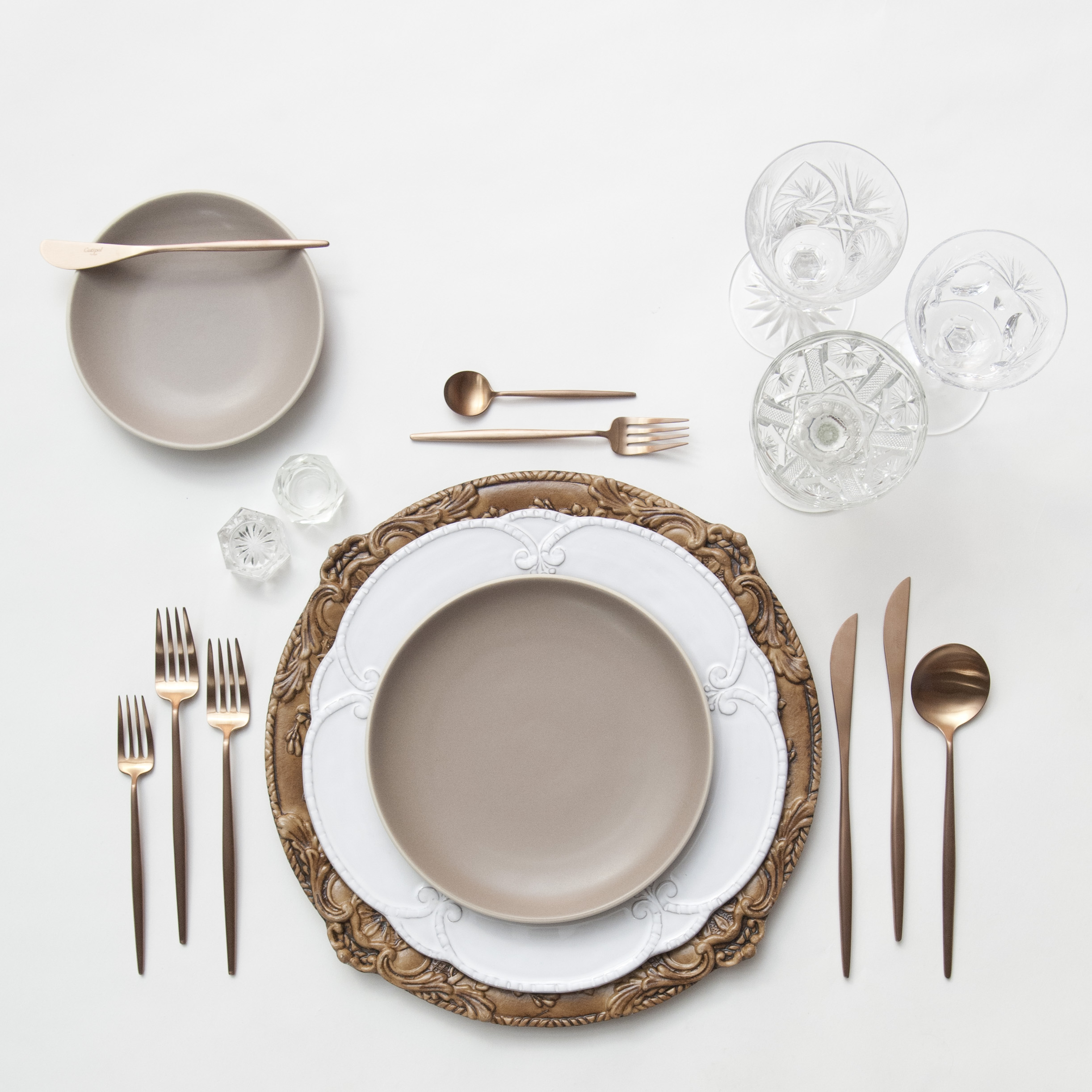 RENT: Verona Chargers in Walnut + Signature Collection Dinnerware + Heath Ceramics in French Grey + Moon Flatware in Brushed Rose Gold + Vintage Cut Crystal Goblets + Vintage Champagne Coupes + Antique Crystal Salt Cellars  SHOP: Verona Chargers in Walnut + Moon Flatware in Brushed Rose Gold