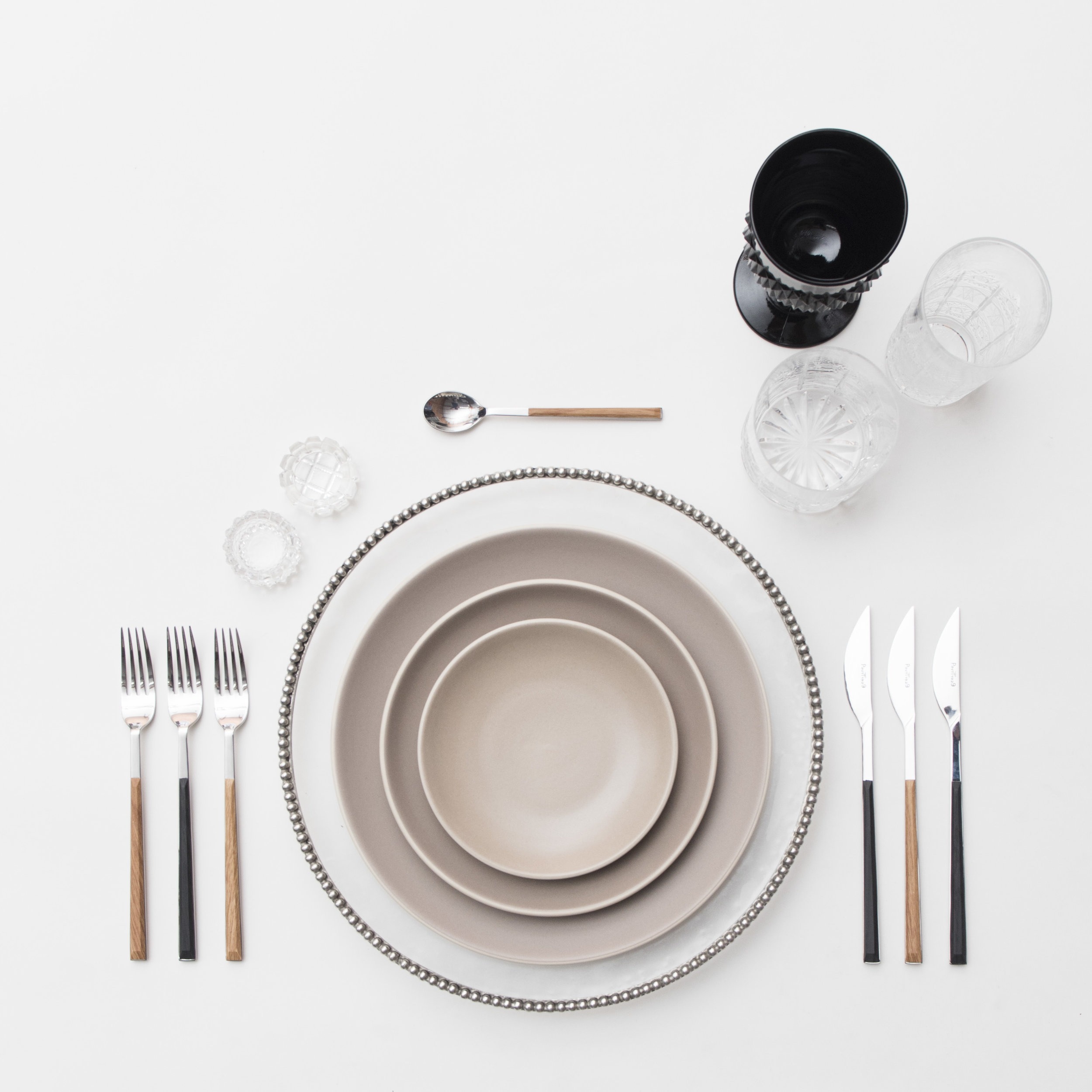 RENT: Pav é Glass  Chargers in Pewter + Heath Ceramics in French Grey + Danish Flatware in Teak/Ebony + Black Vintage Goblets + Czech Crystal Glassware + Antique Crystal Salt Cellars