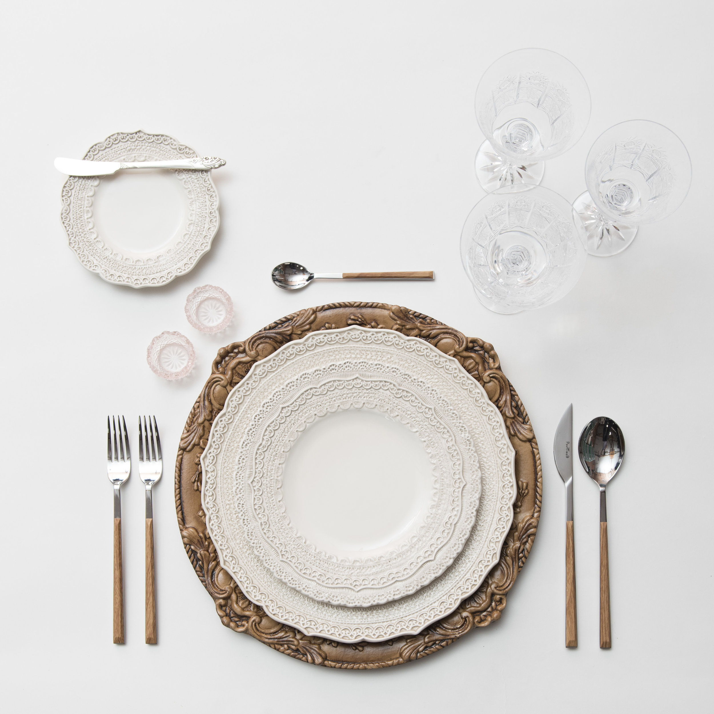 RENT: Verona Chargers in Walnut + Lace Dinnerware in White + Danish Flatware in Teak + Czech Crystal Stemware + Pink Crystal Salt Cellars   SHOP: Verona Chargers in Walnut