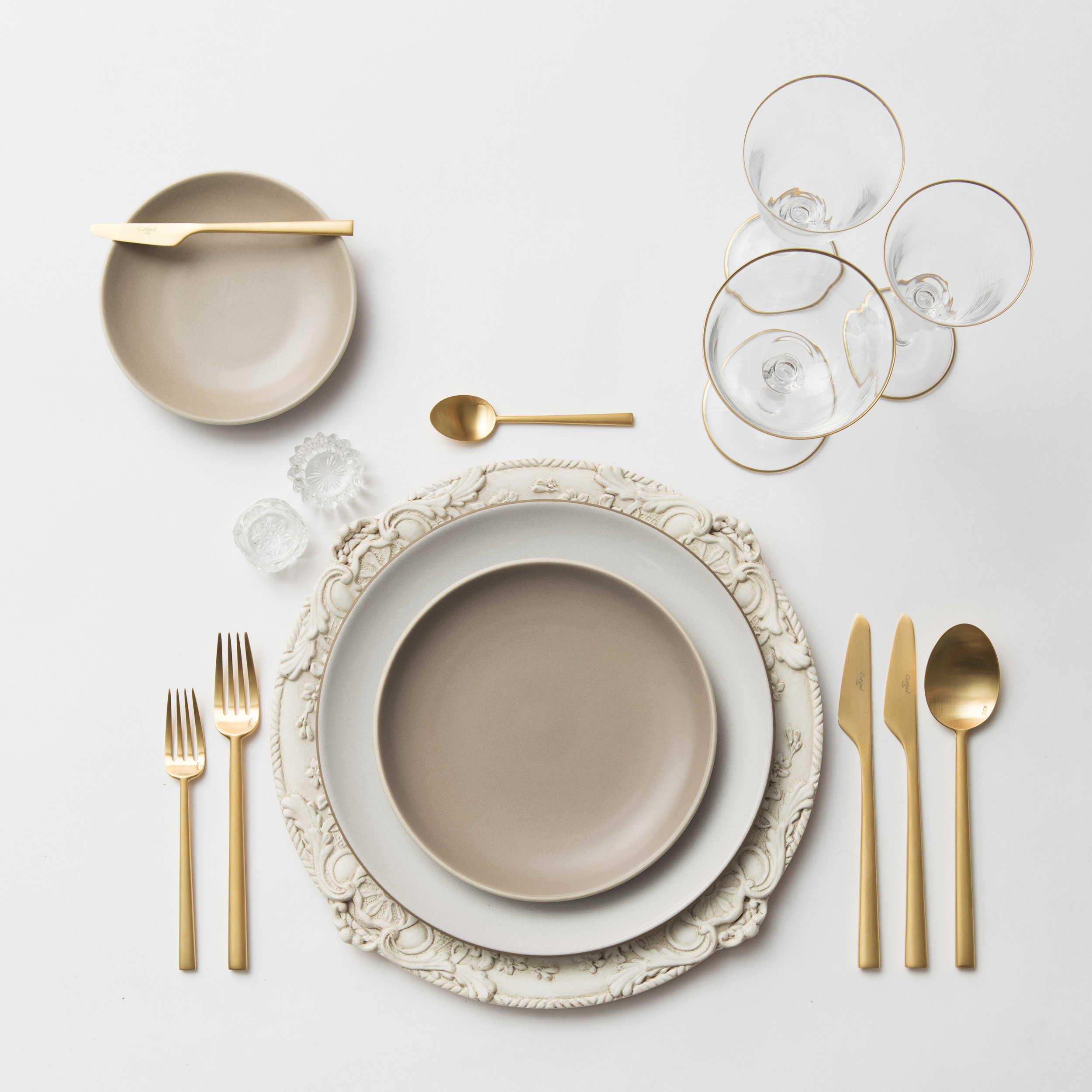 RENT: Verona Chargers in Antique White + Heath Ceramics in Opaque White/French Grey + Rondo Flatware in Brushed 24k Gold + Chloe 24k Gold Rimmed Stemware + Antique Crystal Salt Cellars  SHOP: Verona Chargers in Antique White + Rondo Flatware in Brushed 24k Gold + Chloe 24k Gold Rimmed Stemware