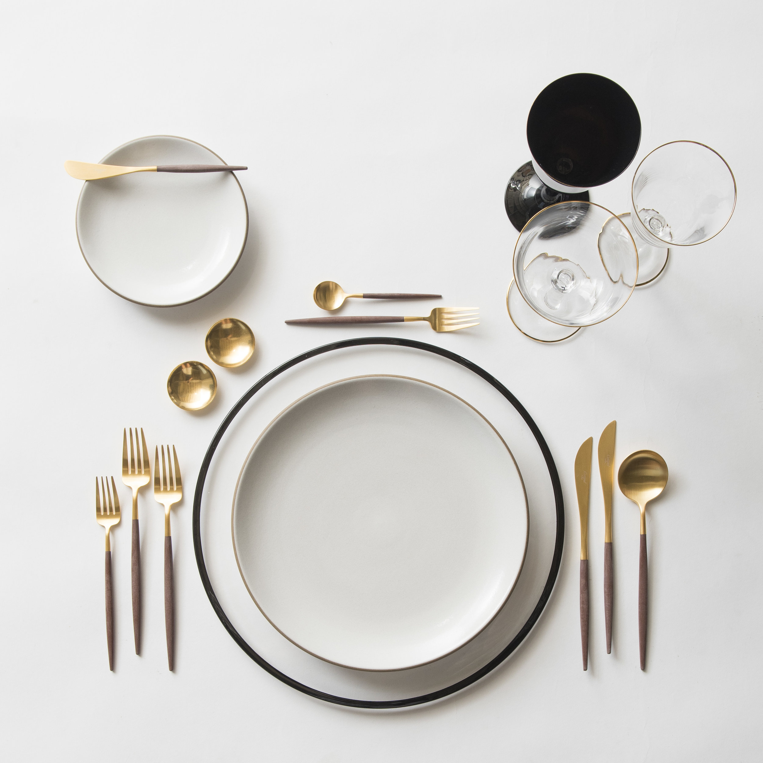 RENT: Halo Glass Chargers in Black + Heath Ceramics in Opaque White + Goa Flatware in Brushed 24k Gold/Wood + Chloe 24k Gold Rimmed Stemware + Chloe 24k Gold Rimmed Goblet in Black + 14k Gold Salt Cellars + Tiny Gold Spoons   SHOP: Halo Glass Chargers in Black + Goa Flatware in Brushed 24k Gold/Wood + Chloe 24k Gold Rimmed Stemware + 14k Gold Salt Cellars + Tiny Gold Spoons