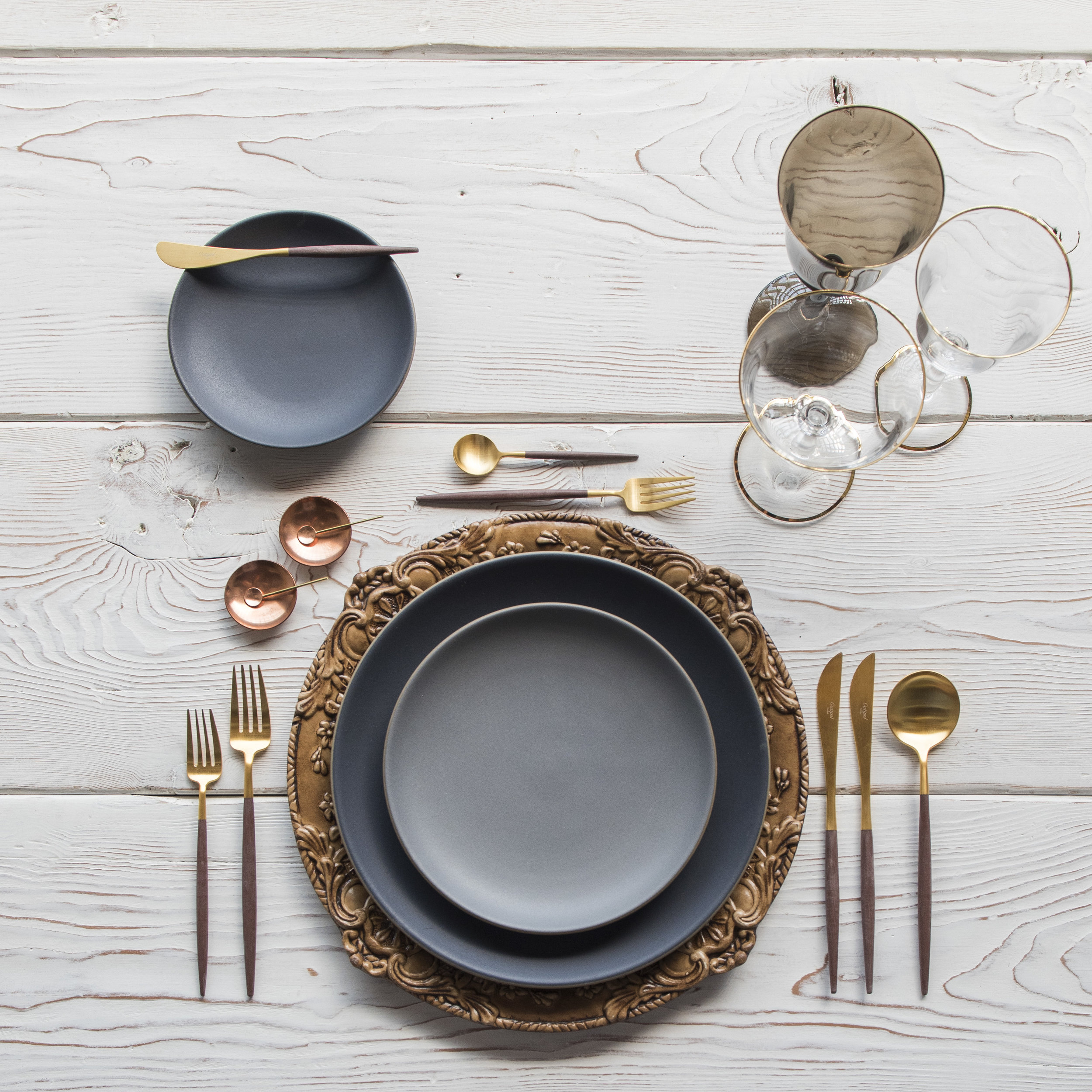 RENT: Verona Chargers in Walnut + Heath Ceramics in Indigo/Slate + Goa Flatware in Brushed 24k Gold/Wood + Chloe 24k Gold Rimmed Stemware + Chloe 24k Gold Rimmed Goblet in Smoke + 14k Gold Salt Cellars + Tiny Gold Spoons  SHOP: Verona Chargers in Walnut + Goa Flatware in Brushed 24k Gold/Wood + Chloe 24k Gold Rimmed Stemware + 14k Gold Salt Cellars + Tiny Gold Spoons