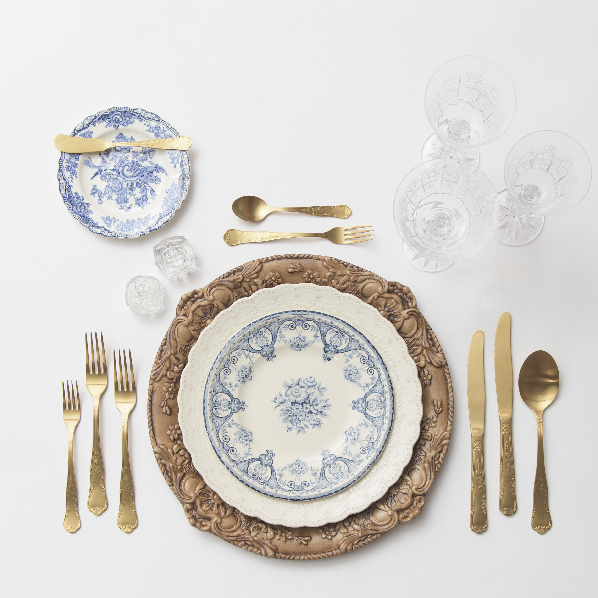 RENT: Verona Charger in Walnut + White Collection Vintage China + Blue Garden Collection Vintage China + Chateau Flatware in Matte Gold + Czech Crystal Stemware + Antique Crystal Salt Cellars   SHOP: Verona Charger in Walnut
