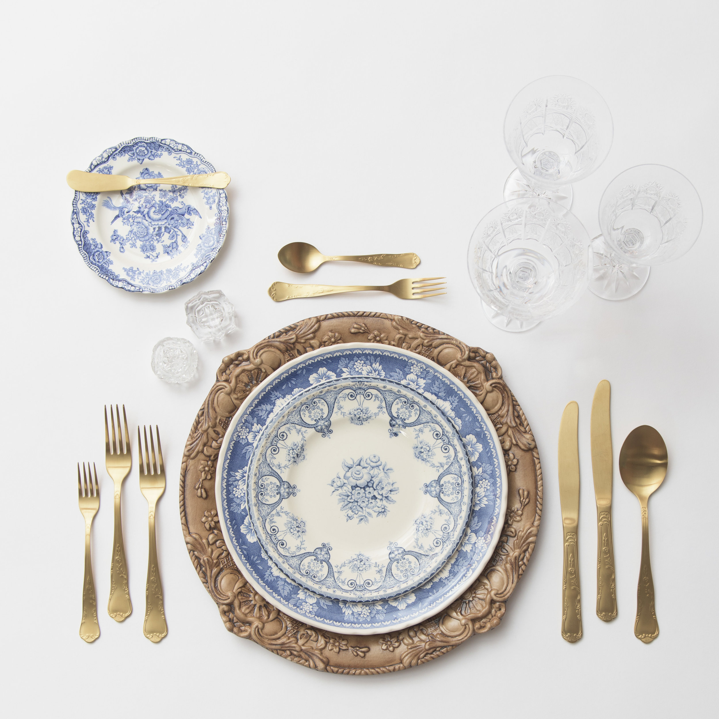 RENT: Verona Charger in Walnut + Blue Garden Collection Vintage China + Chateau Flatware in Matte Gold + Czech Crystal Stemware + Antique Crystal Salt Cellars   SHOP: Verona Charger in Walnut