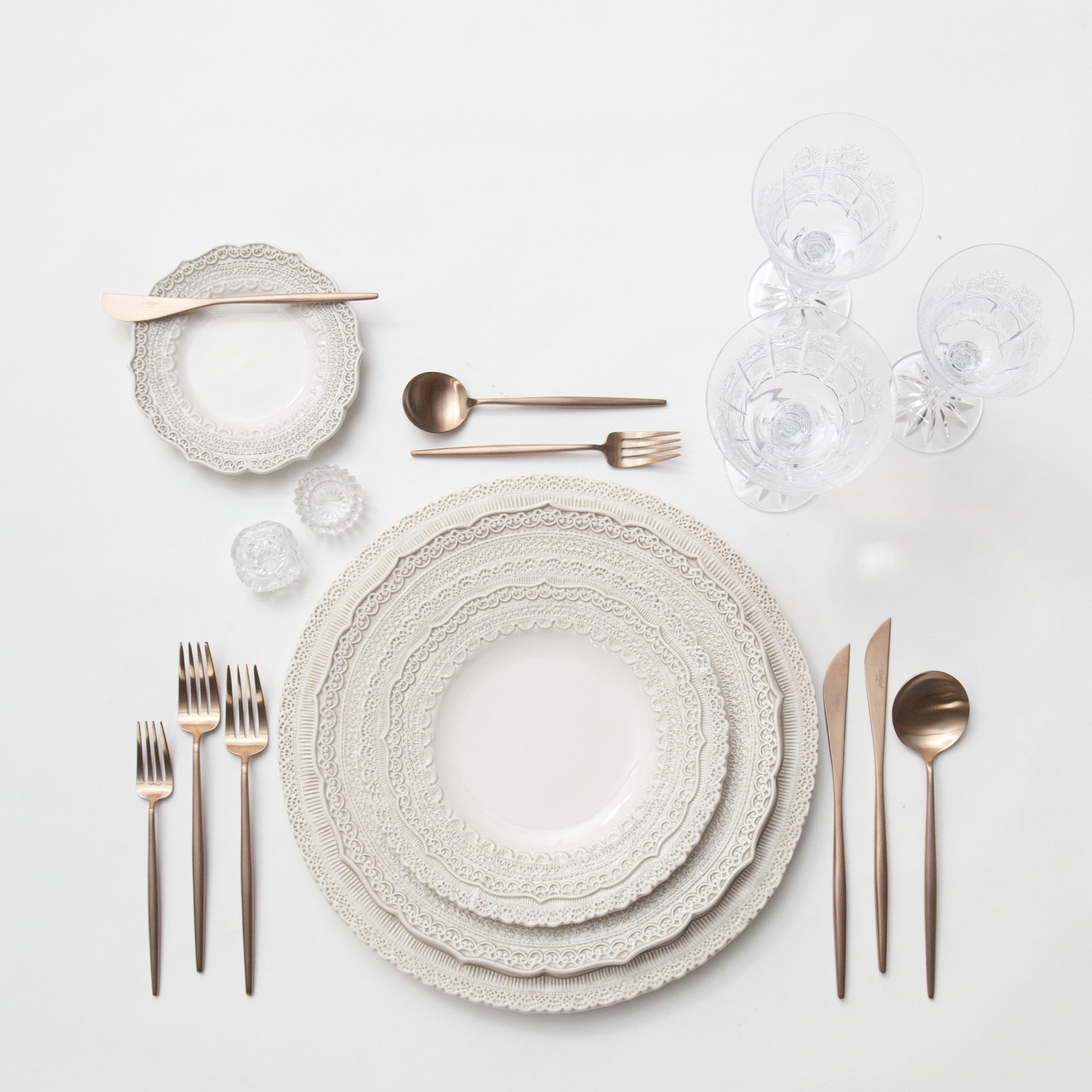 RENT: Lace Chargers/Dinnerware in White + Moon Flatware in Brushed Rose Gold + Czech Crystal Stemware + Antique Crystal Salt Cellars  SHOP:Moon Flatware in Brushed Rose Gold