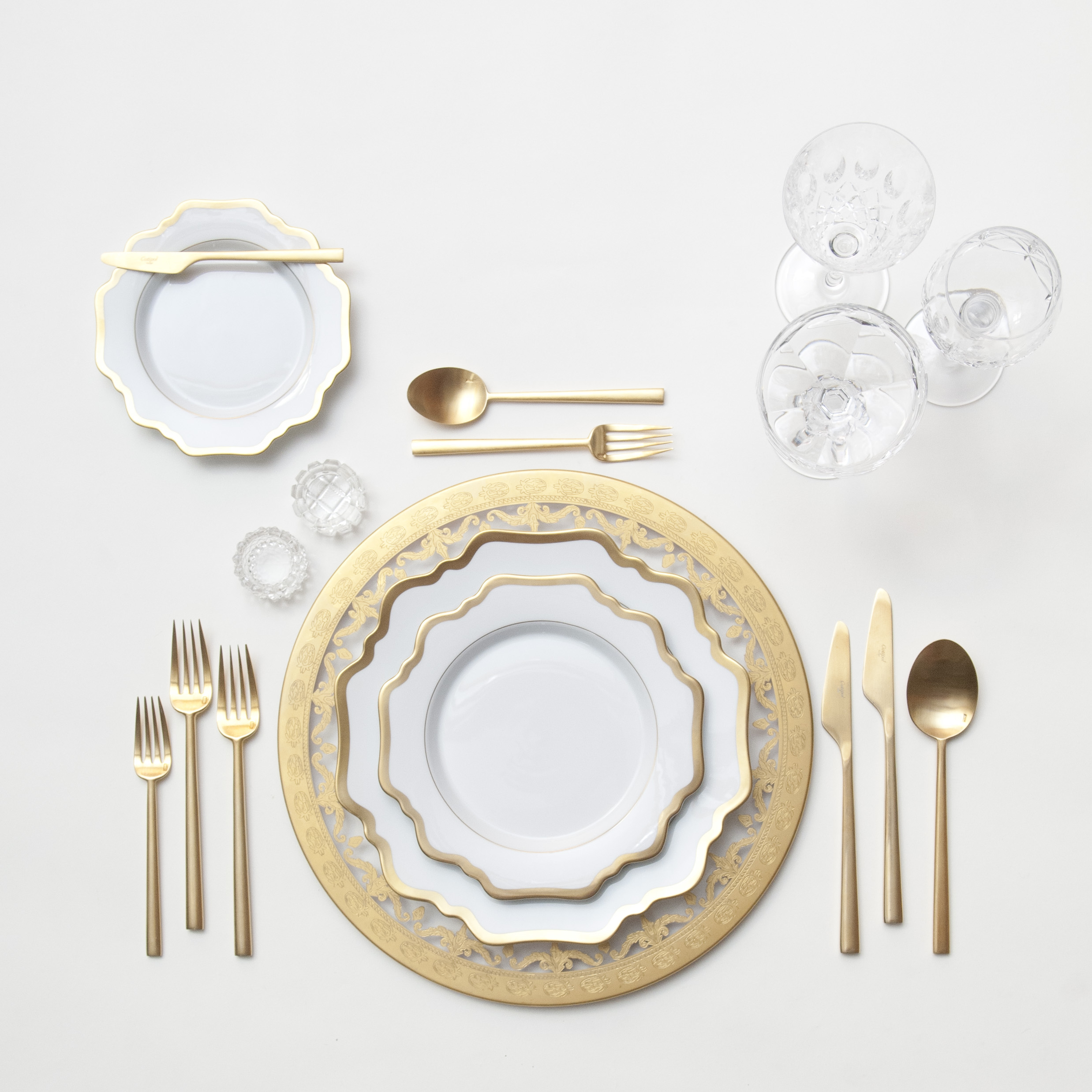 RENT: Versailles Glass Chargers in 24k Gold + Anna Weatherley Dinnerware in White/Gold + Rondo Flatware in Brushed 24k Gold + Vintage Cut Crystal Goblets + Vintage Champagne Coupes + Antique Crystal Salt Cellars  SHOP:Anna Weatherley Dinnerware in White/Gold + Rondo Flatware in Brushed 24k Gold
