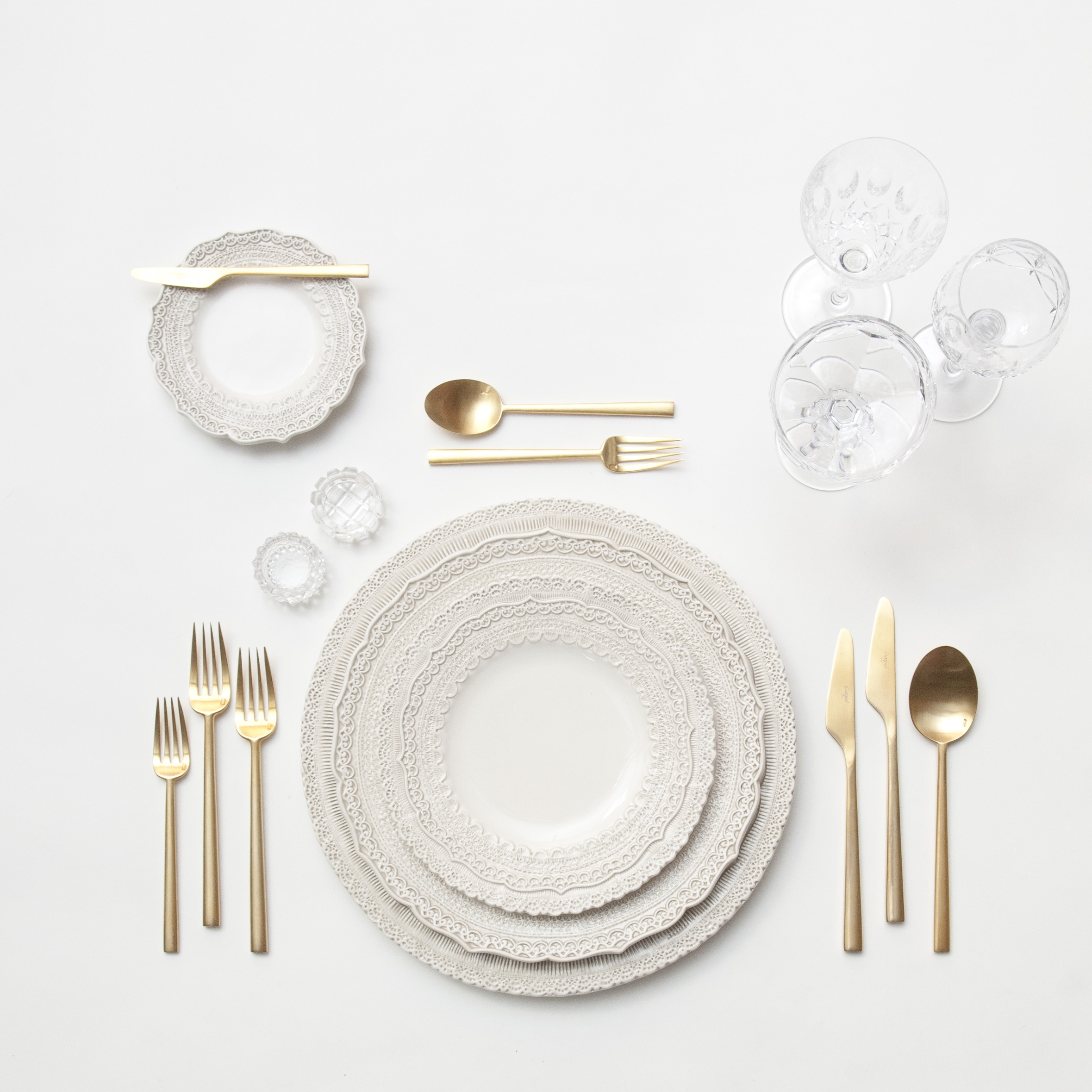 RENT: Lace Chargers/Dinnerware in White + Rondo Flatware in Brushed 24k Gold + Vintage Cut Crystal Goblets + Vintage Champagne Coupes + Antique Crystal Salt Cellars  SHOP: Rondo Flatware in Brushed 24k Gold