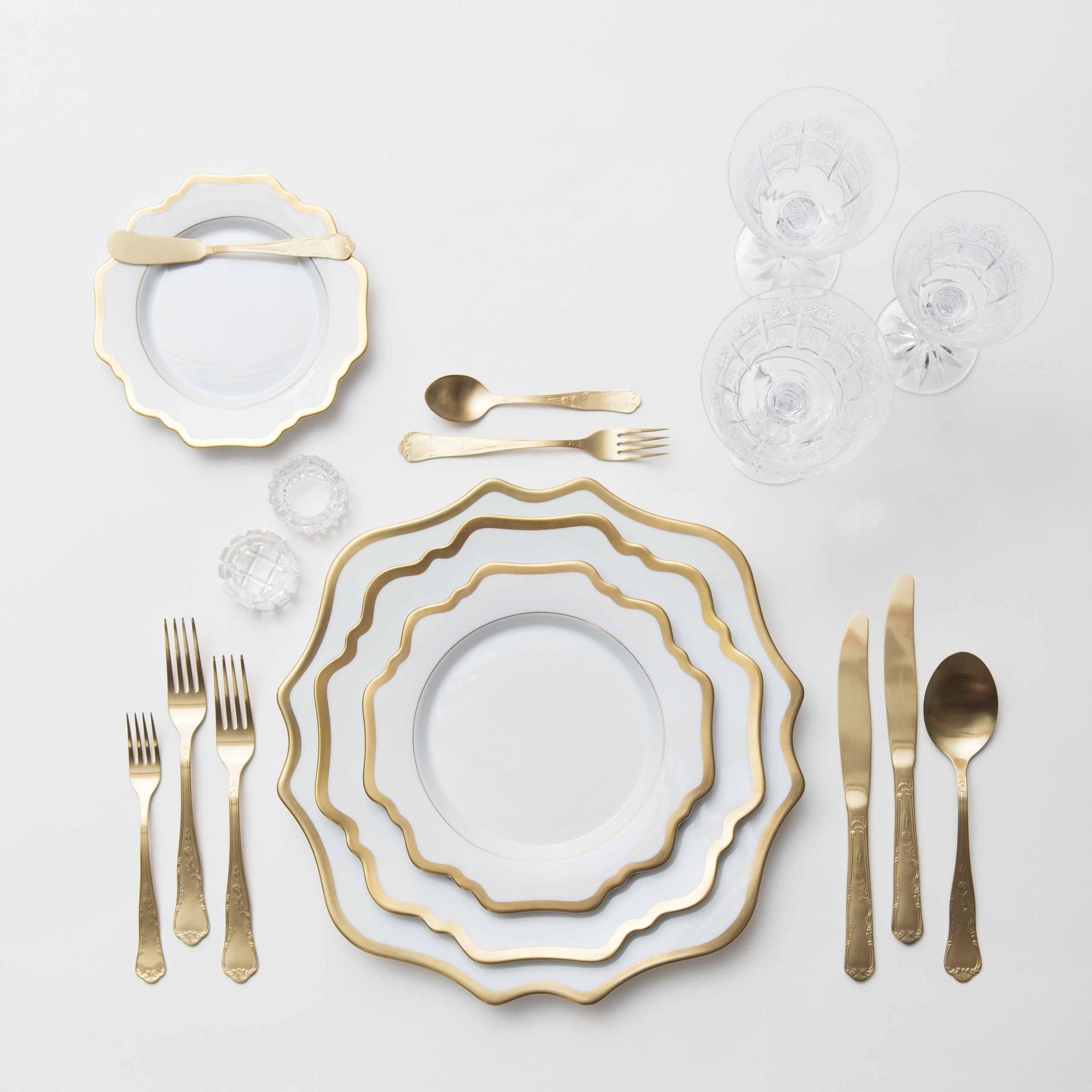 RENT: Anna Weatherley Chargers/Dinnerware in White/Gold + Chateau Flatware in Matte Gold + Czech Crystal Stemware +Antique Crystal Salt Cellars  SHOP: Anna Weatherley Chargers/Dinnerware in White/Gold