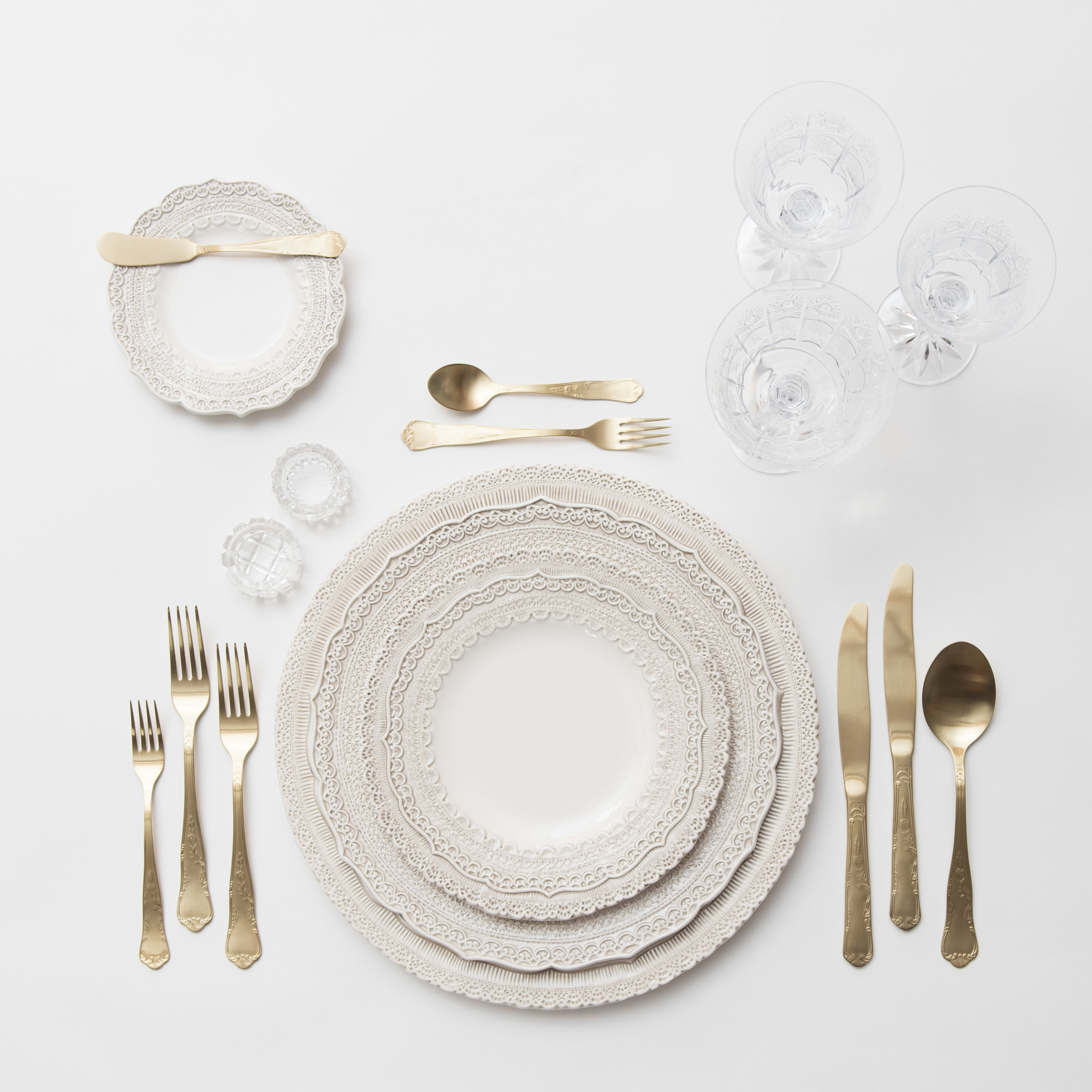 RENT:Lace Chargers/Dinnerware in White + Chateau Flatware in Matte Gold + Czech Crystal Stemware +Antique Crystal Salt Cellars