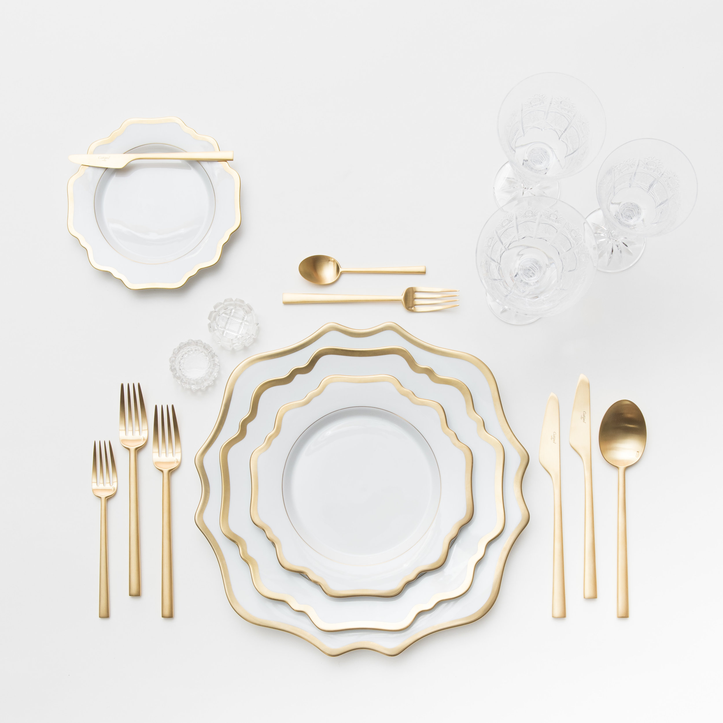 RENT: Anna Weatherley Chargers/Dinnerware in White/Gold + Rondo Flatware in Brushed 24k Gold + Czech Crystal Stemware +Antique Crystal Salt Cellars  SHOP:Anna Weatherley Chargers/Dinnerware in White/Gold + Rondo Flatware in Brushed 24k Gold