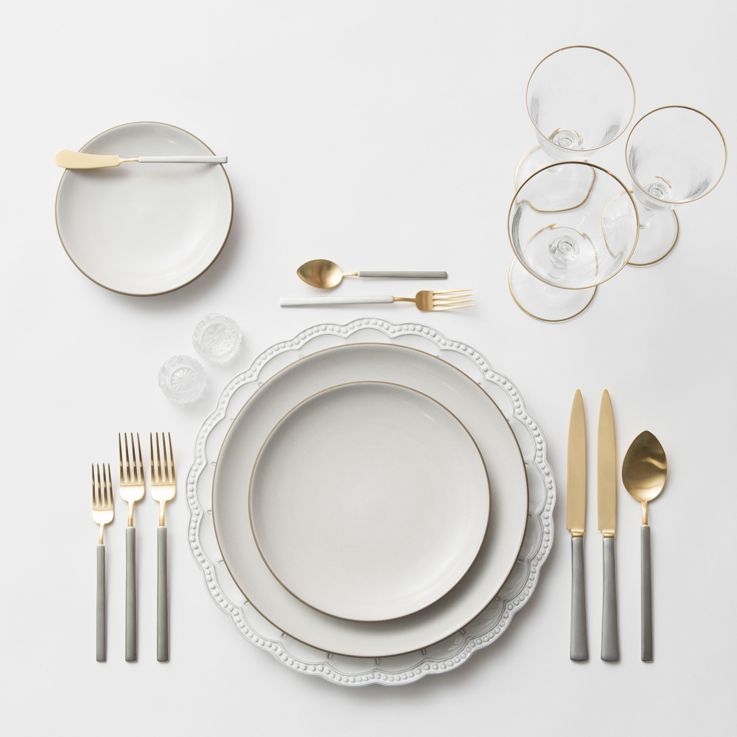 RENT: Signature Collection Chargers + Heath Ceramics in Opaque White + Axel Flatware in Matte 24k Gold/Silver + Chloe 24k Gold Rimmed Stemware + Antique Crystal Salt Cellars   SHOP:Chloe 24k Gold Rimmed Stemware