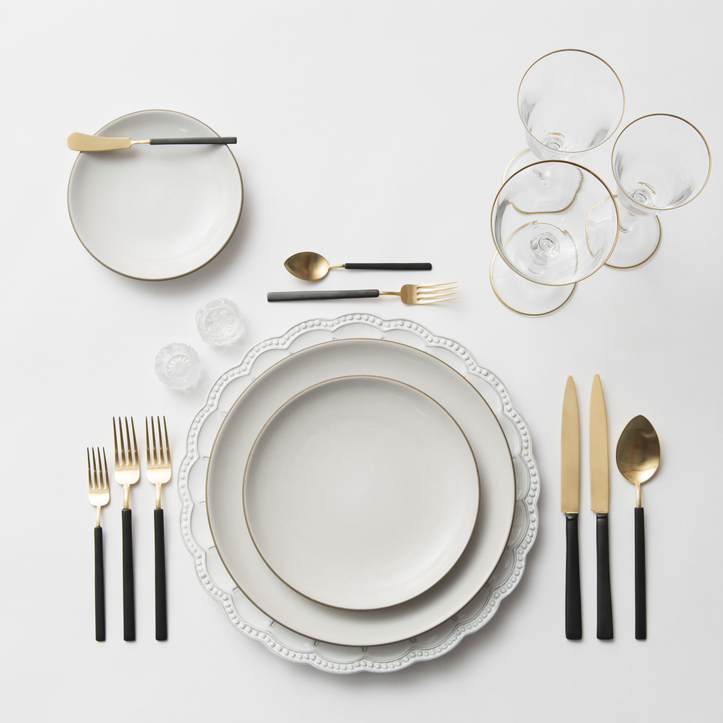 RENT: Signature Collection Chargers + Heath Ceramics in Opaque White + Axel Flatware in Matte 24k Gold/Black + Chloe 24k Gold Rimmed Stemware + Antique Crystal Salt Cellars  SHOP:Chloe 24k Gold Rimmed Stemware