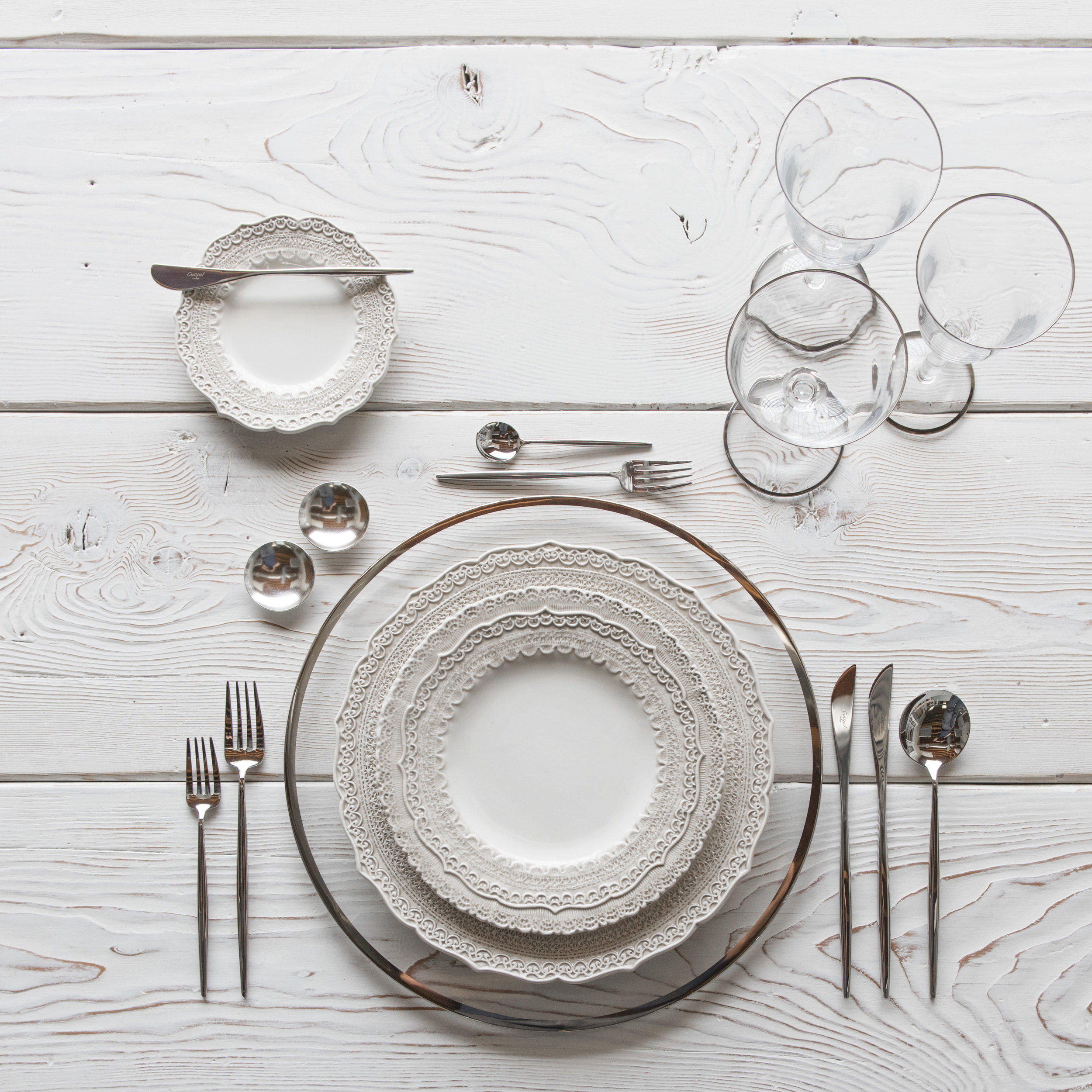 RENT: Halo Glass Chargers in Platinum + Lace Dinnerware in White + Moon Flatware in Polished Steel + Chloe Platinum Rimmed Glassware + Silver Salt Cellars  SHOP:Halo Glass Chargers in Platinum +Moon Flatware in Polished Steel + Chloe Platinum Rimmed Glassware
