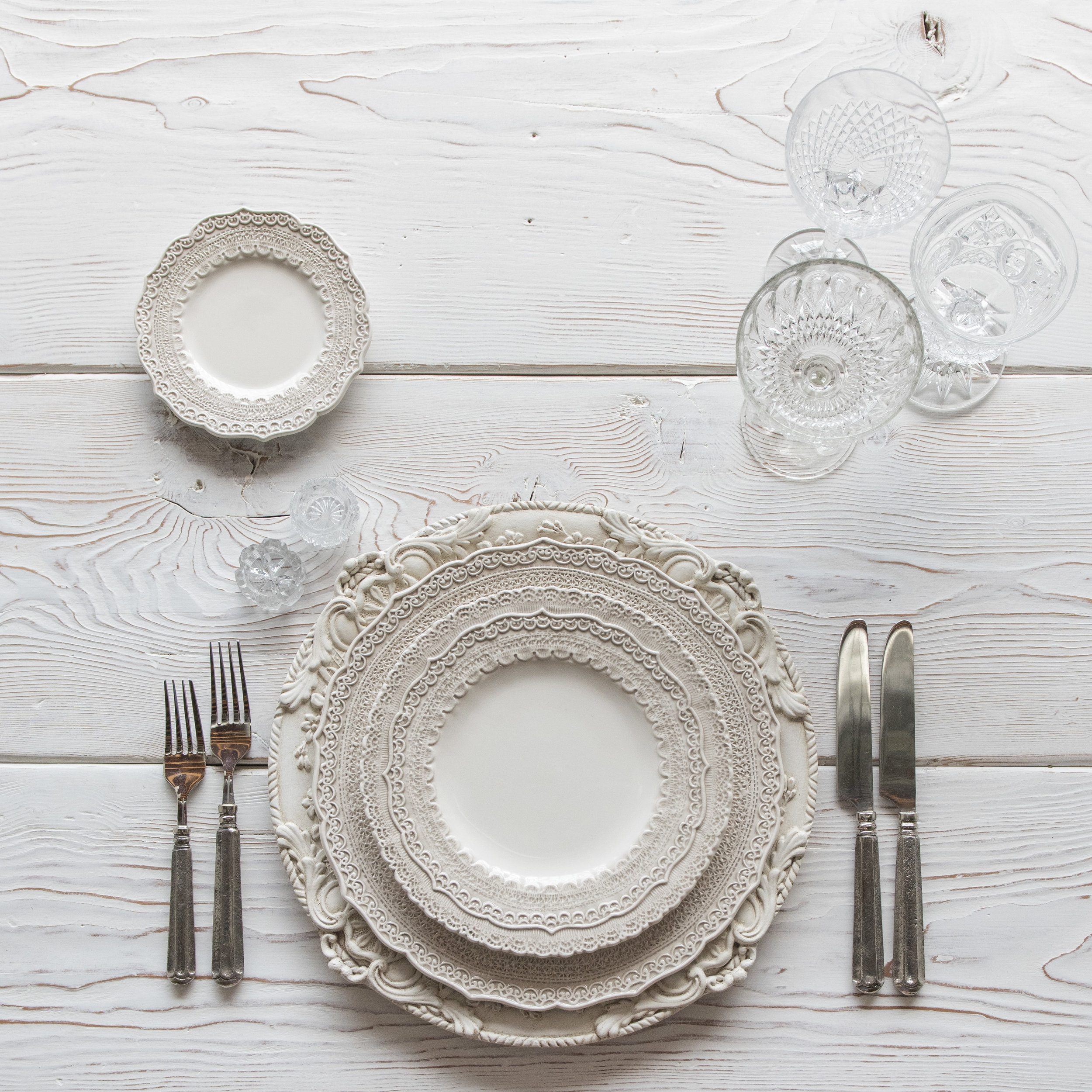 RENT: Verona Chargers in Antique White + Lace Dinnerware in White + Tuscan Flatware in Pewter + Vintage Cut Crystal Goblets + Early American Pressed Glass Goblets + Vintage Champagne Coupes + Antique Crystal Salt Cellars  SHOP:Verona Chargers in Antique White