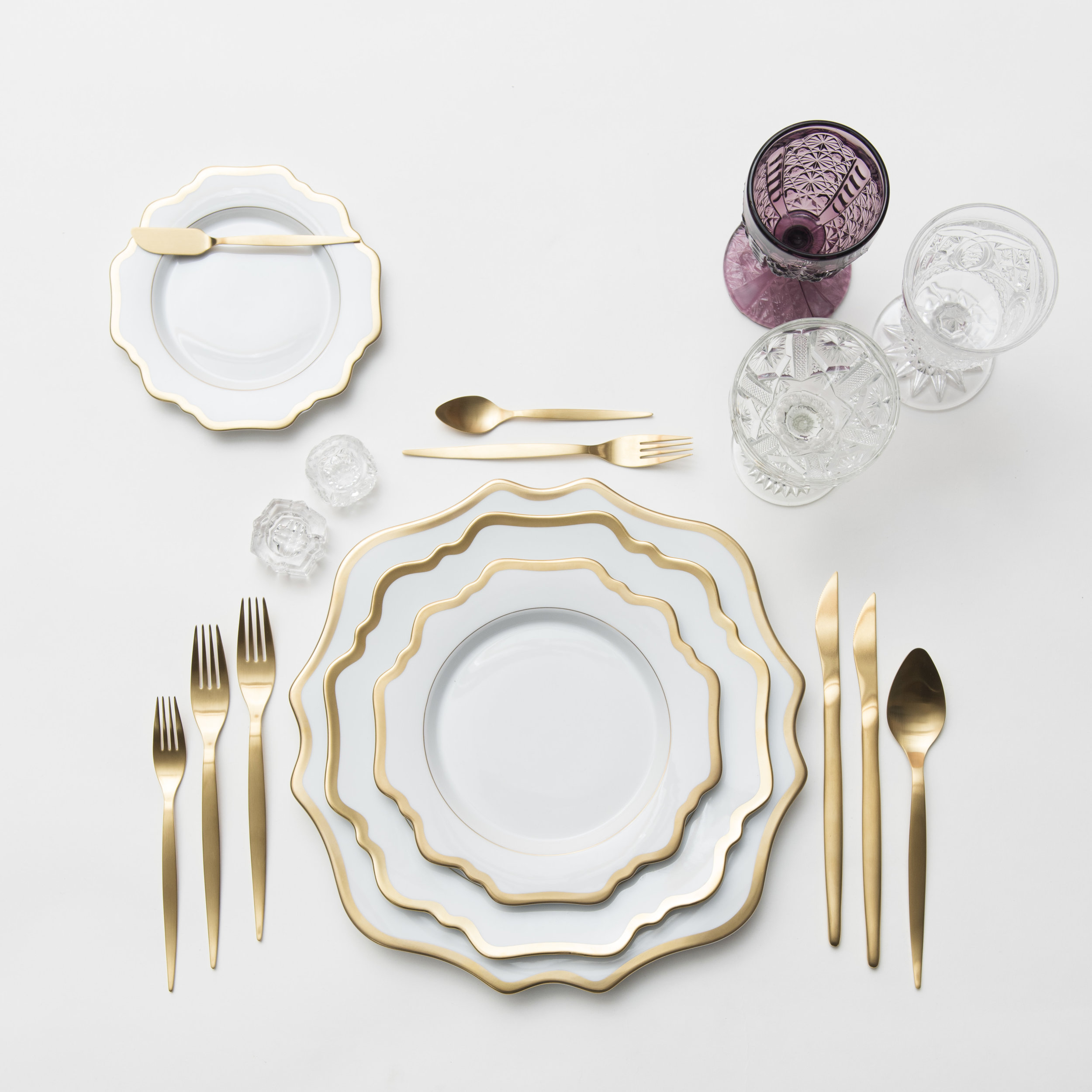 RENT: Anna Weatherley Chargers/Dinnerware in White/Gold + Celeste Flatware in Matte Gold + Purple Vintage Goblets + Early American Pressed Glass Goblets + Vintage Champagne Coupes + Antique Crystal Salt Cellars  SHOP:Anna Weatherley Chargers/Dinnerware in White/Gold