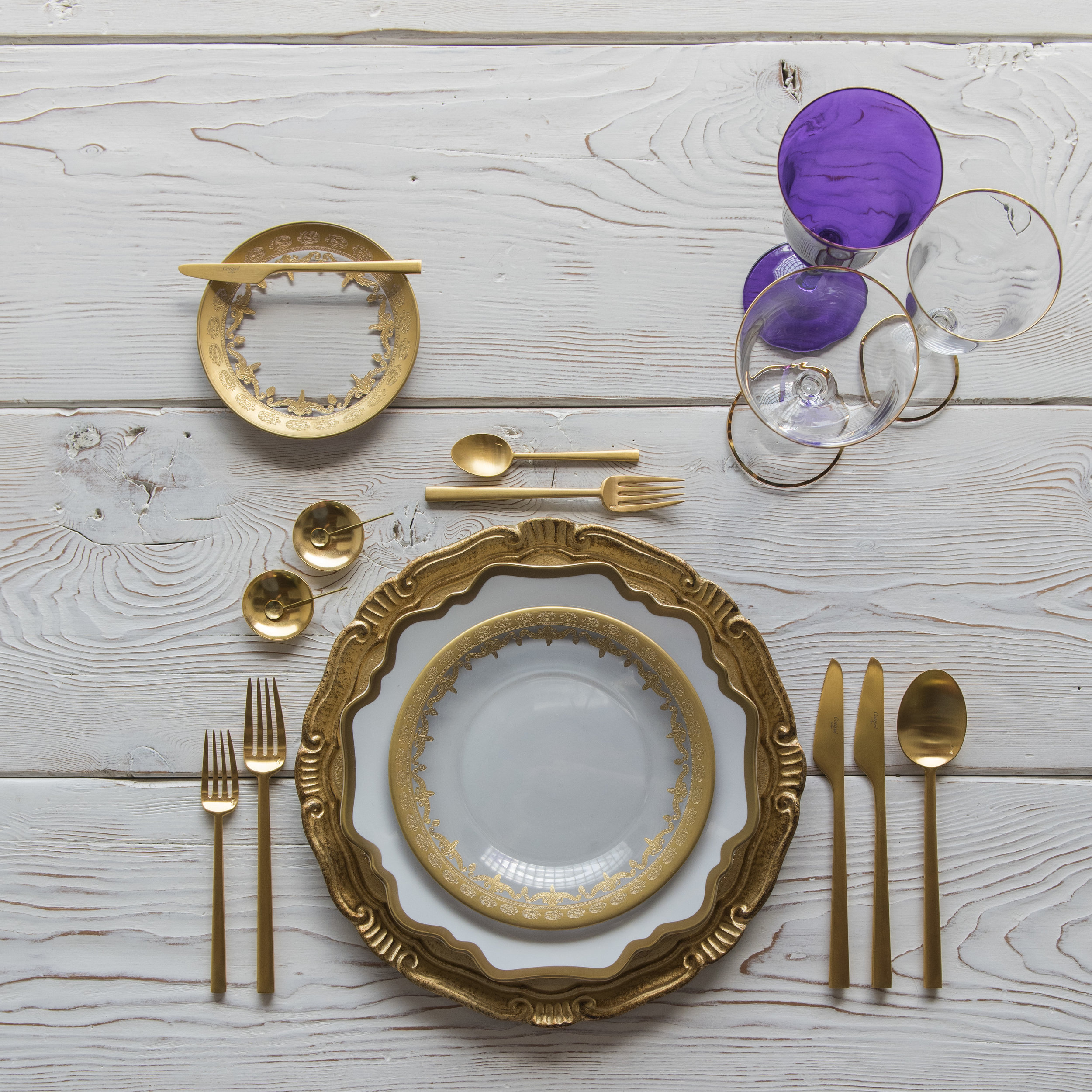 RENT: Florentine Chargers in Gold + Anna Weatherley Dinnerware in White/Gold + Versailles Glass Dinnerware in 24k Gold + Rondo Flatware in Brushed 24k Gold + Chloe 24k Gold Rimmed Stemware + Chloe 24k Gold Rimmed Goblet in Purple + 14k Gold Salt Cellars + Tiny Gold Spoons  SHOP:Florentine Chargers in Gold +Anna Weatherley Dinnerware in White/Gold +Rondo Flatware in Brushed 24k Gold + Chloe 24k Gold Rimmed Stemware + 14k Gold Salt Cellars + Tiny Gold Spoons