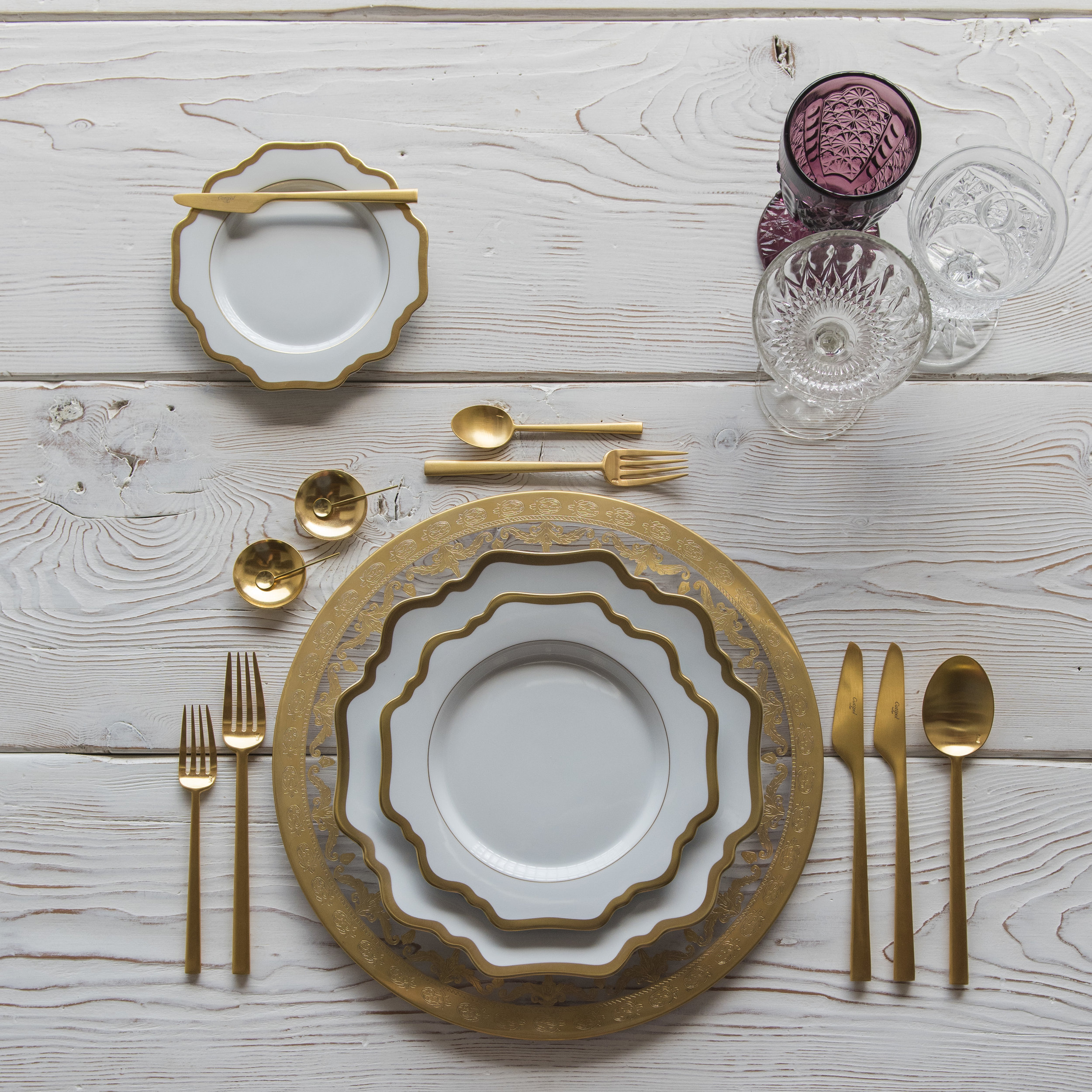 RENT: Versailles Glass Chargers in 24k Gold + Anna Weatherley Dinnerware in White/Gold + Rondo Flatware in Brushed 24k Gold + Purple Vintage Goblets + Early American Pressed Glass Goblets + Vintage Champagne Coupes + 14k Gold Salt Cellars + Tiny Gold Spoons  SHOP:Anna Weatherley Dinnerware in White/Gold + Rondo Flatware in Brushed 24k Gold + 14k Gold Salt Cellars + Tiny Gold Spoons