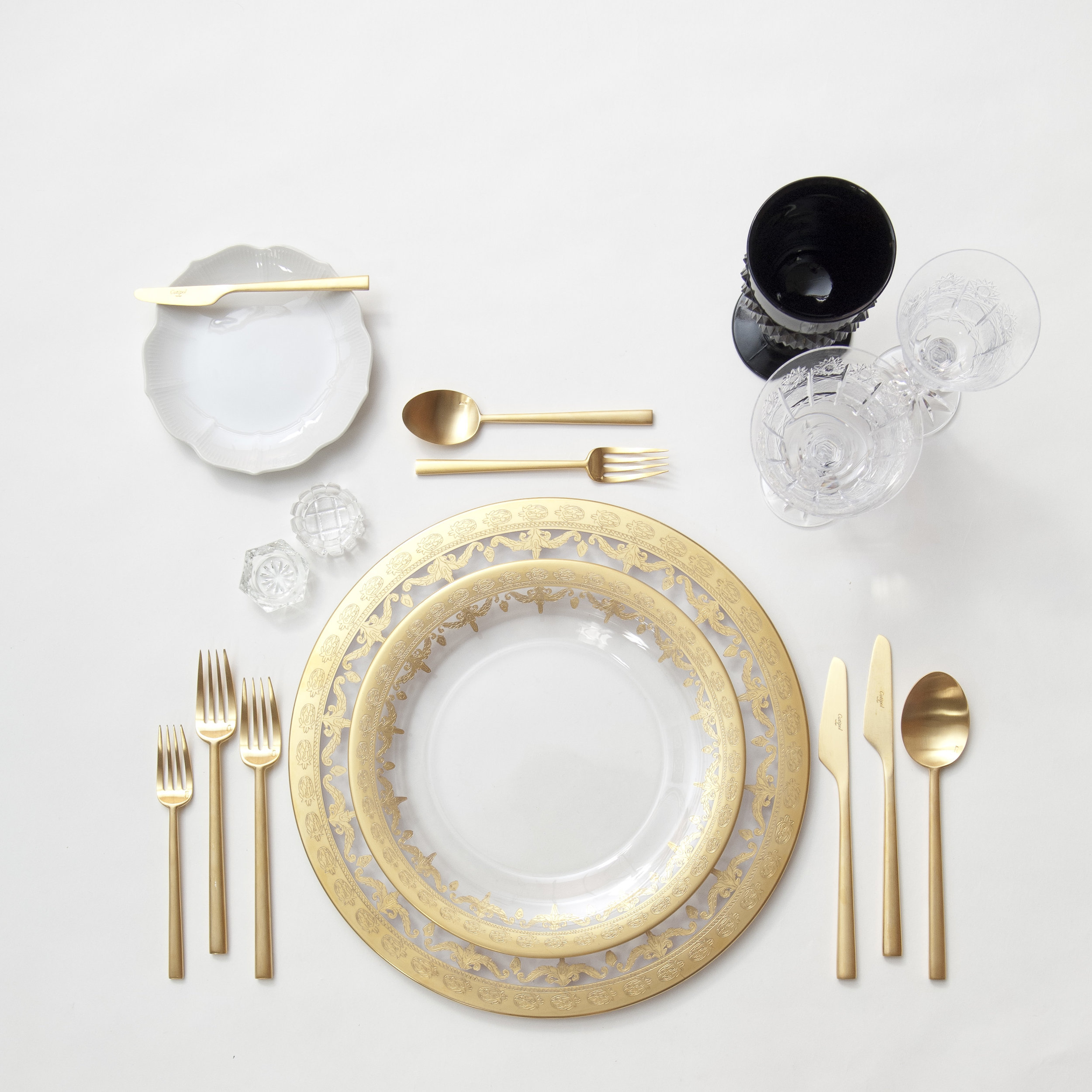 RENT: Versailles Glass Chargers/Dinnerware in 24k Gold + White Collection Vintage China + Rondo Flatware in Brushed 24k Gold + Black Vintage Goblets + Czech Crystal Stemware + Antique Crystal Salt Cellars  SHOP: Rondo Flatware in Brushed 24k Gold