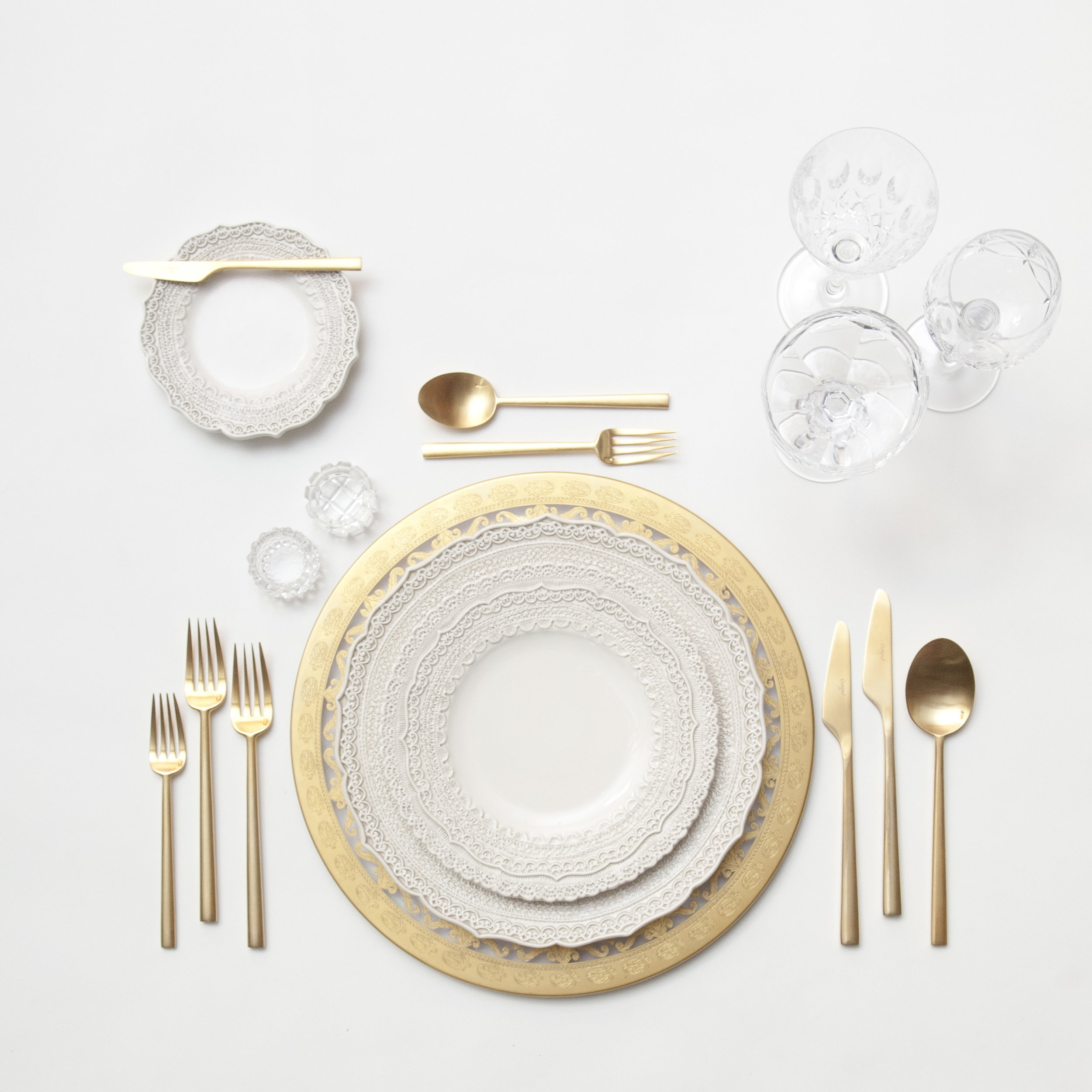 RENT: Versailles Glass Chargers in 24k Gold + Lace Dinnerware in White + Rondo Flatware in Brushed 24k Gold + Vintage Cut Crystal Goblets + Vintage Champagne Coupes + Antique Crystal Salt Cellars  SHOP: Rondo Flatware in Brushed 24k Gold