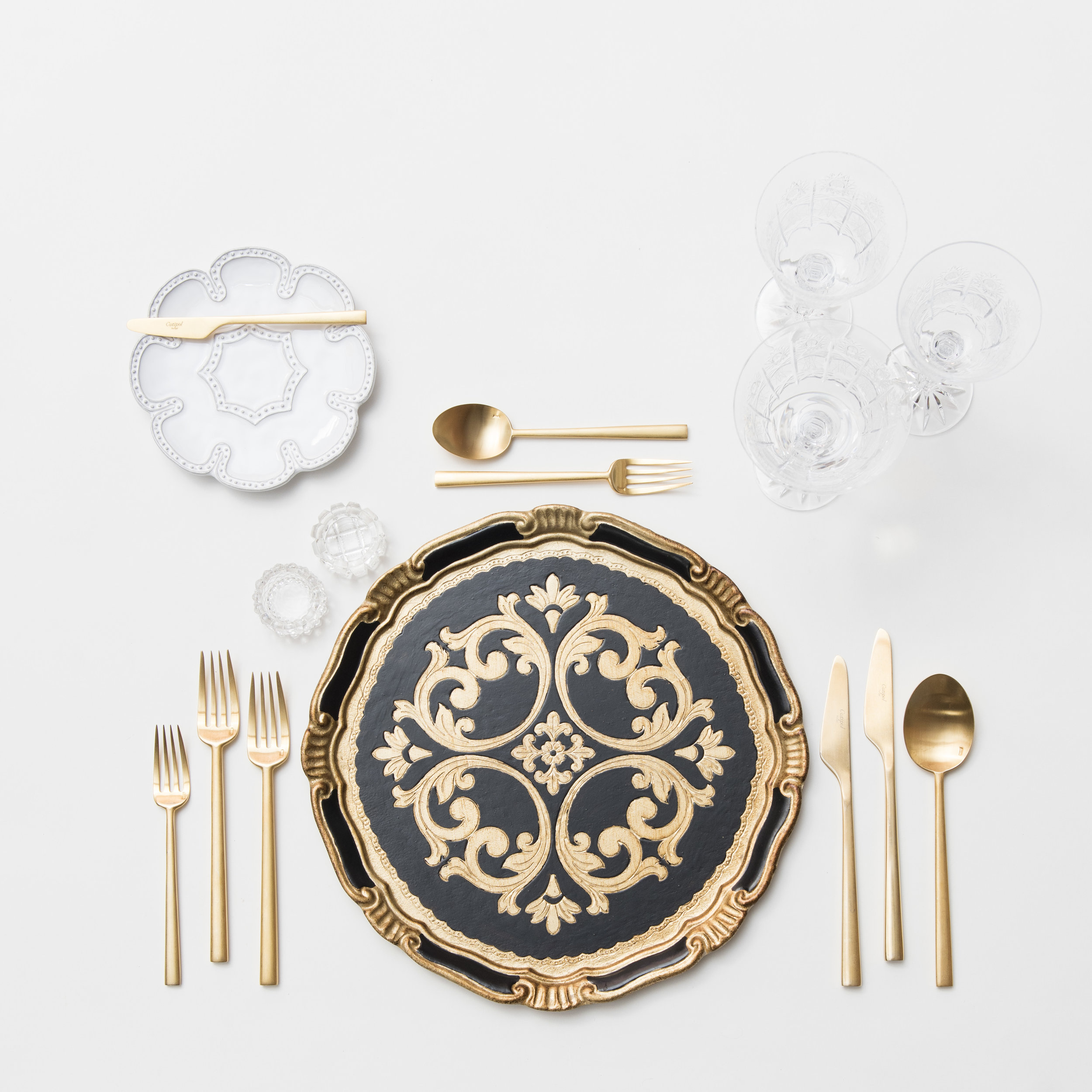 RENT: Florentine Chargers in Black/Gold + Signature Collection Dinnerware + Rondo Flatware in Brushed 24k Gold + Czech Crystal Stemware + Antique Crystal Salt Cellars  SHOP: Florentine Chargers in Black/Gold + Rondo Flatware in Brushed 24k Gold