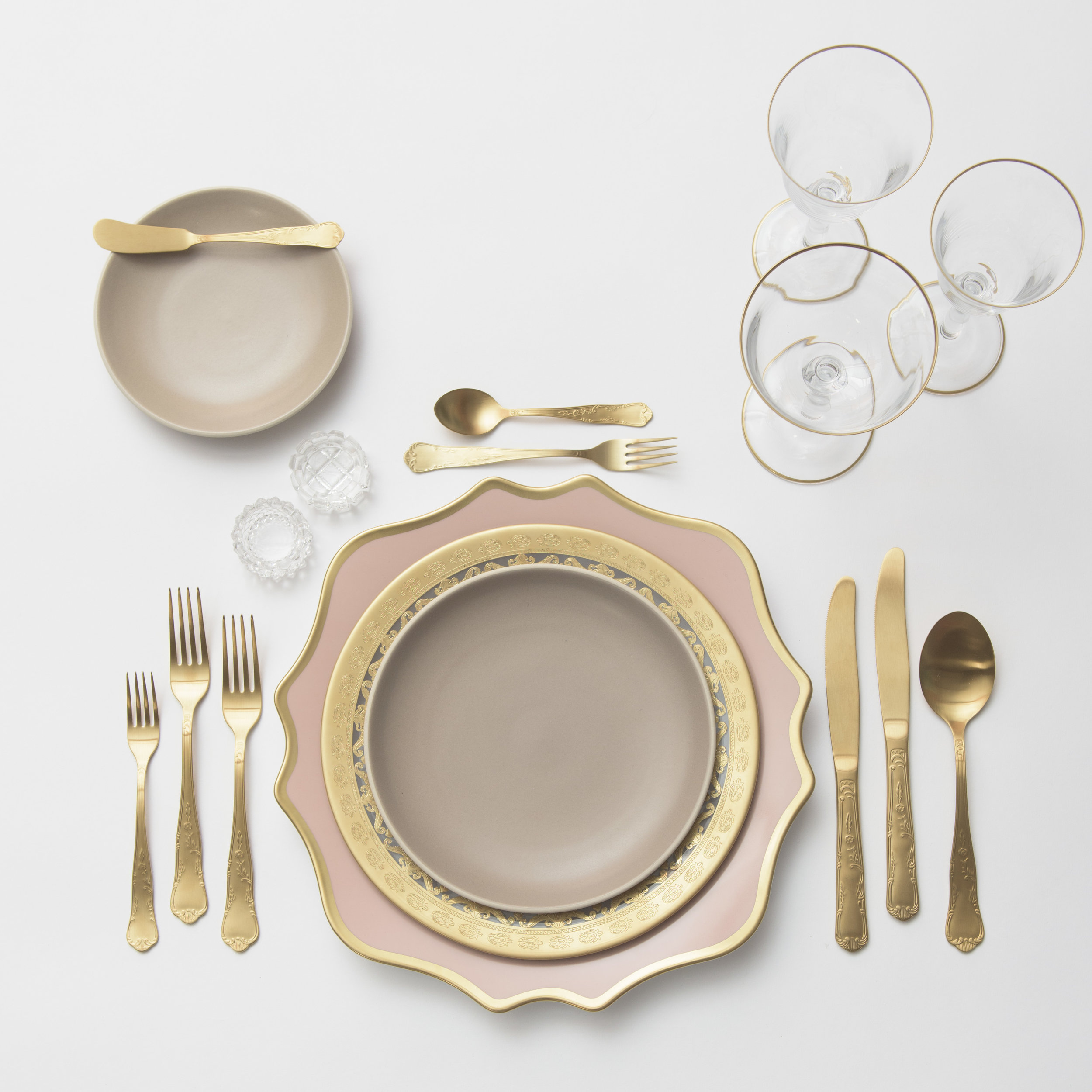 RENT: Anna Weatherley Chargers in Desert Rose/Gold + Versailles Glass Dinnerware in 24k Gold + Heath Ceramics in French Grey + Chateau Flatware in Matte Gold + Chloe 24k Gold Rimmed Stemware + Antique Crystal Salt Cellars  SHOP: Chloe 24k Gold Rimmed Stemware