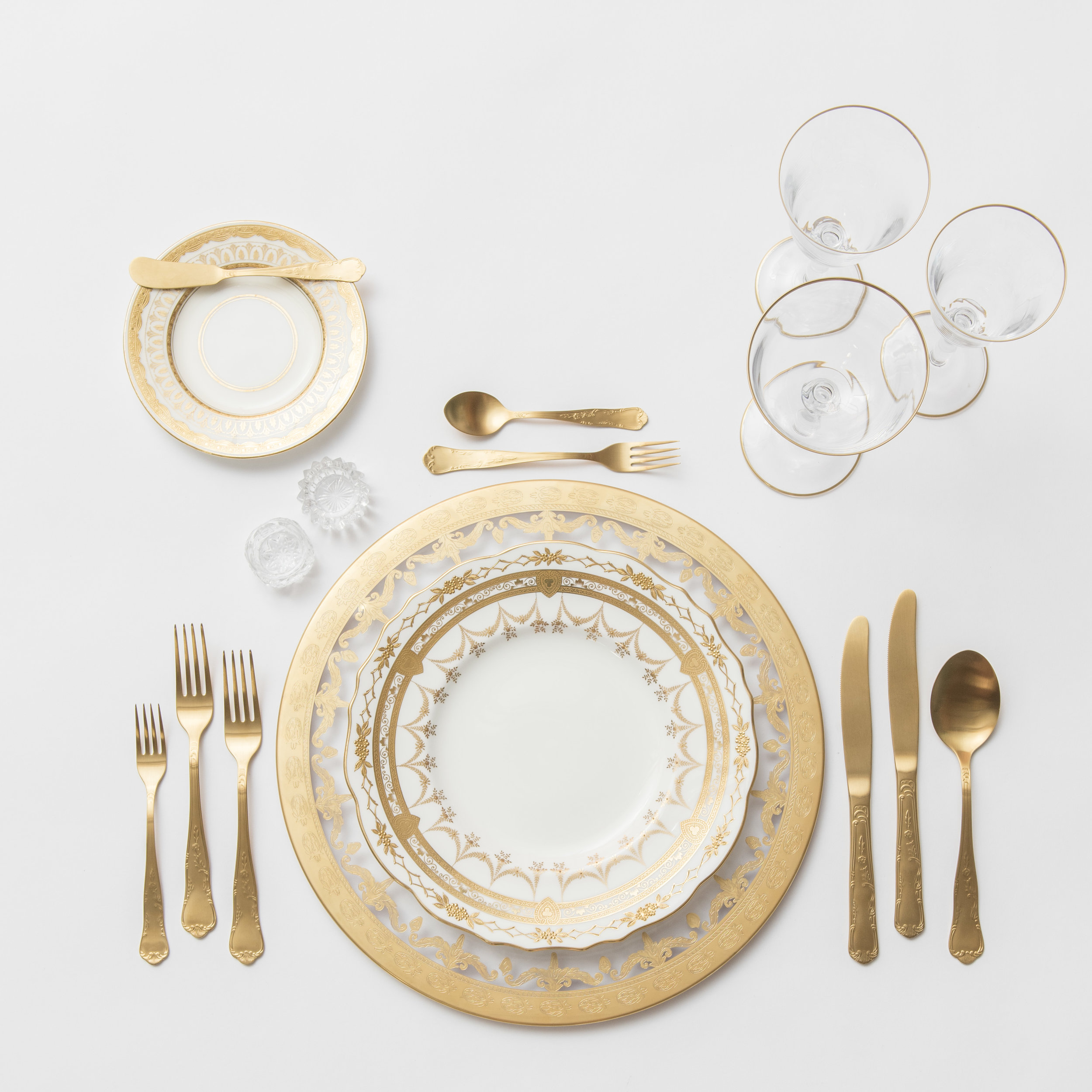 RENT: Versailles Glass Chargers in 24k Gold + Crown Gold Collection Vintage China + Chateau Flatware in Matte Gold + Chloe 24k Gold Rimmed Stemware + Antique Crystal Salt Cellars  SHOP: Chloe 24k Gold Rimmed Stemware