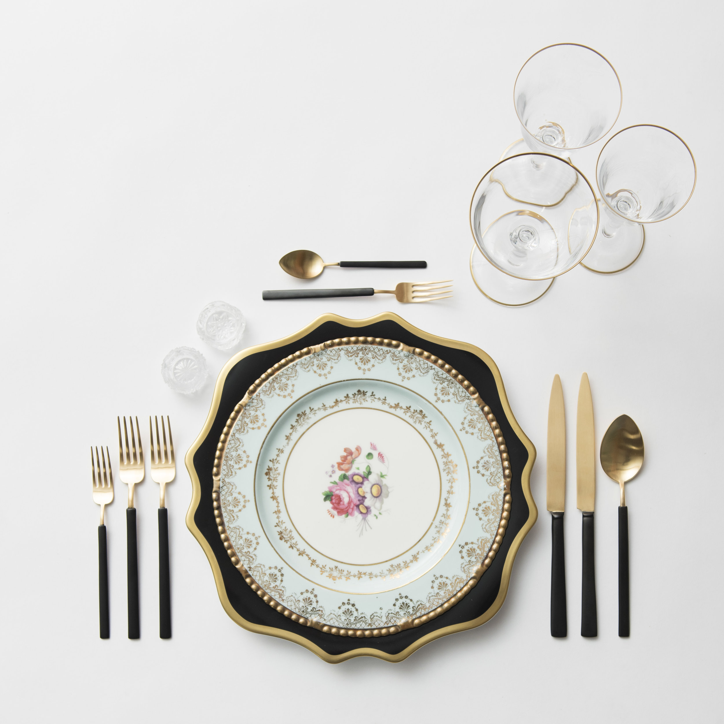 RENT: Anna Weatherley Chargers in Black/Gold + Blue Botanicals Vintage China + Axel Flatware in Matte 24k Gold/Black + Chloe 24k Gold Rimmed Stemware + Antique Crystal Salt Cellars  SHOP: Chloe 24k Gold Rimmed Stemware