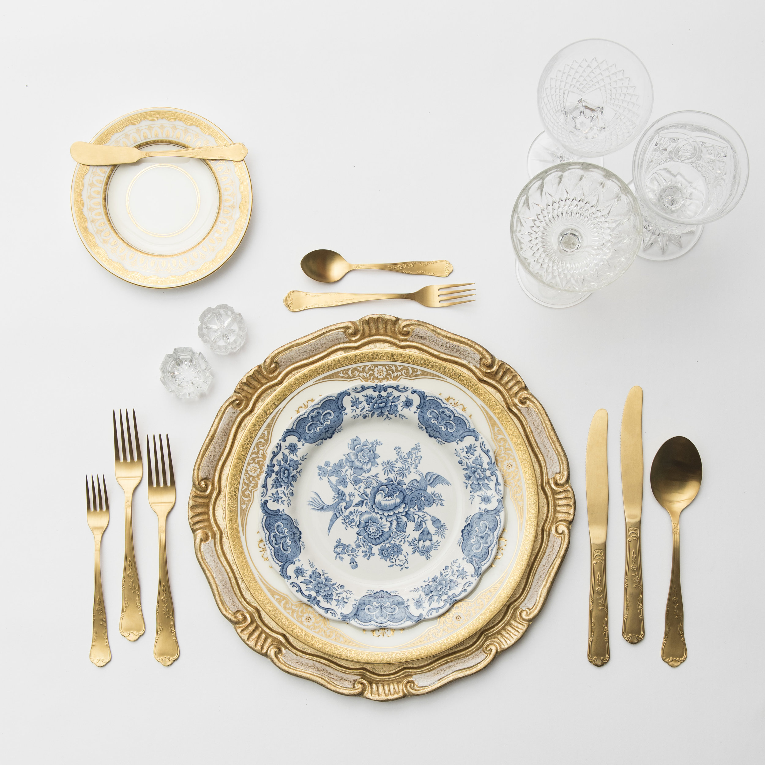 RENT: Florentine Chargers in White/Gold + Crown Gold Collection Vintage China + Blue Garden Collection Vintage China + Chateau Flatware in Matte Gold + Vintage Cut Crystal Goblets + Early American Pressed Glass Goblets + Vintage Champagne Coupes + Antique Crystal Salt Cellars   SHOP: Florentine Chargers in White/Gold