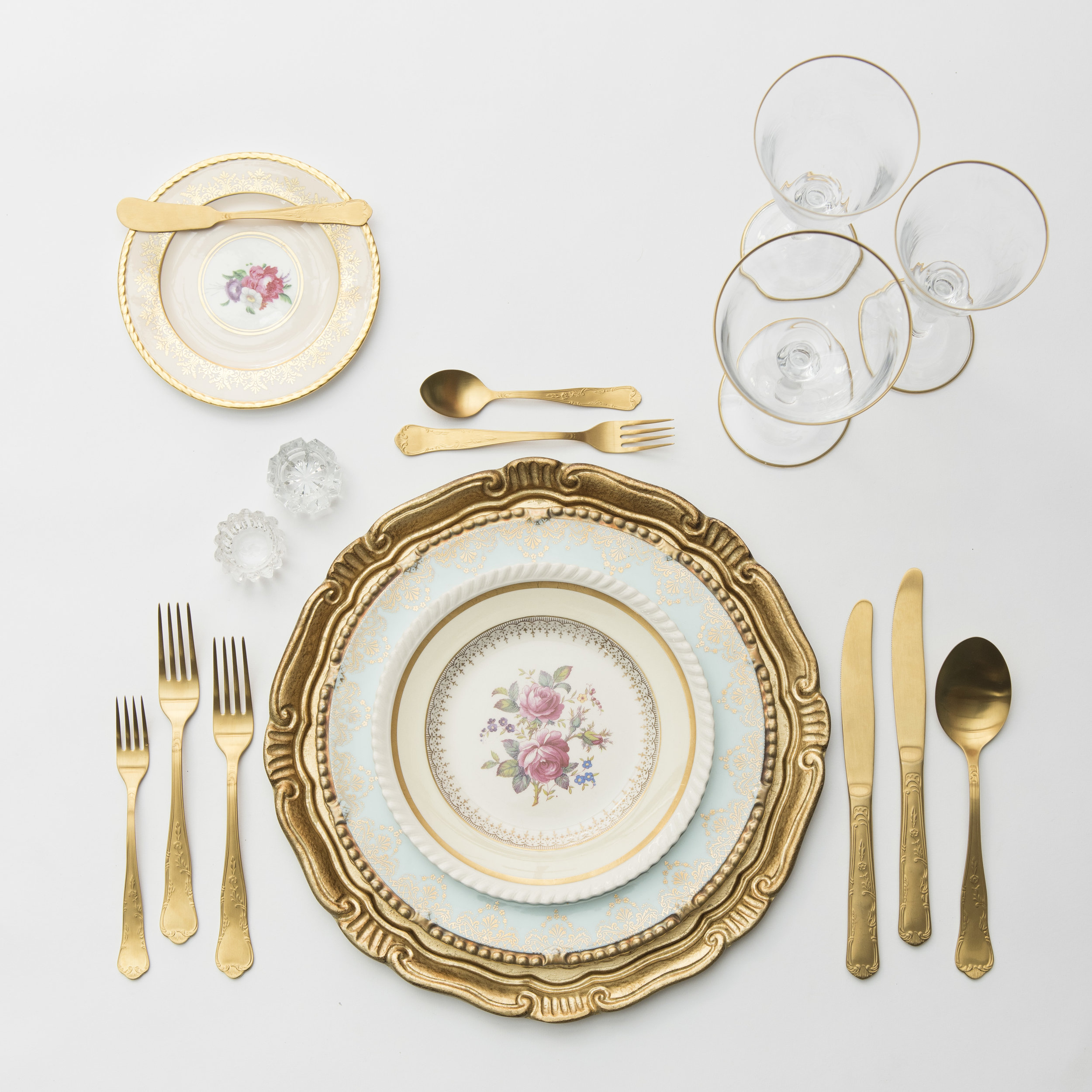 RENT: Florentine Charger in Gold + Blue/White Botanicals Vintage China + Chateau Flatware in Matte Gold + Chloe 24k Gold Rimmed Stemware + Antique Crystal Salt Cellars  SHOP: Florentine Charger in Gold + Chloe 24k Gold Rimmed Stemware