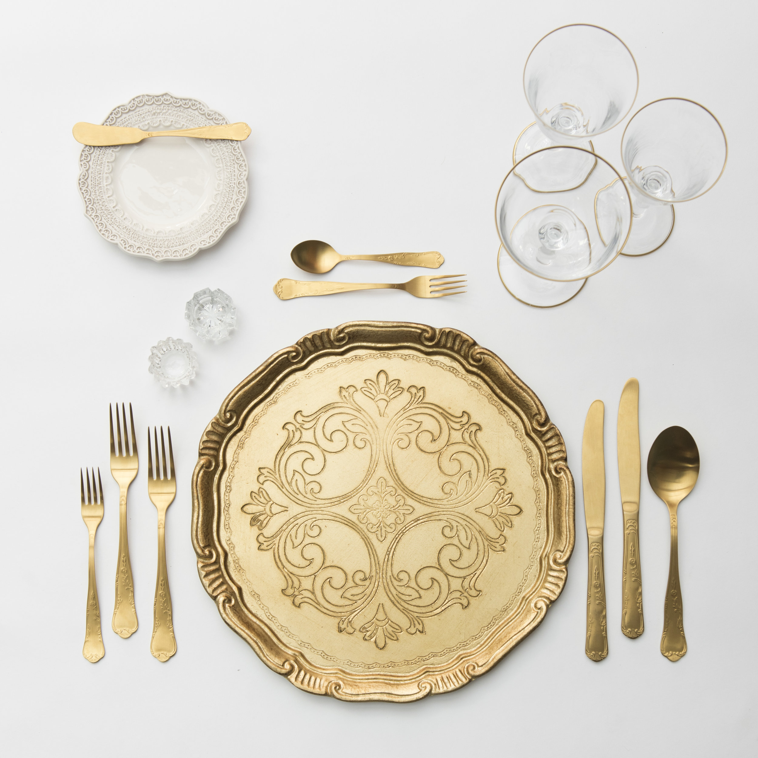 RENT: Florentine Chargers in Gold + Lace Dinnerware in White + Chateau Flatware in Matte Gold + Chloe 24k Gold Rimmed Stemware + Antique Crystal Salt Cellars   SHOP: Florentine Chargers in Gold + Chloe 24k Gold Rimmed Stemware