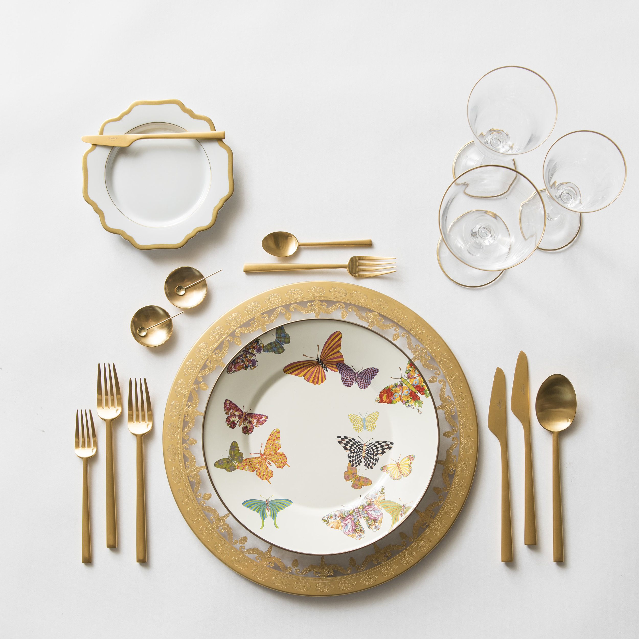 RENT: Versailles Glass Chargers in 24k Gold + Anna Weatherley Dinnerware in White/Gold + MacKenzie-Childs Butterfly Garden Collection + Rondo Flatware in Brushed 24k Gold + Chloe 24k Gold Rimmed Stemware + 14k Gold Salt Cellars + Tiny Gold Spoons   SHOP: Anna Weatherley Dinnerware in White/Gold + Rondo Flatware in Brushed 24k Gold + Chloe 24k Gold Rimmed Stemware + 14k Gold Salt Cellars + Tiny Gold Spoons