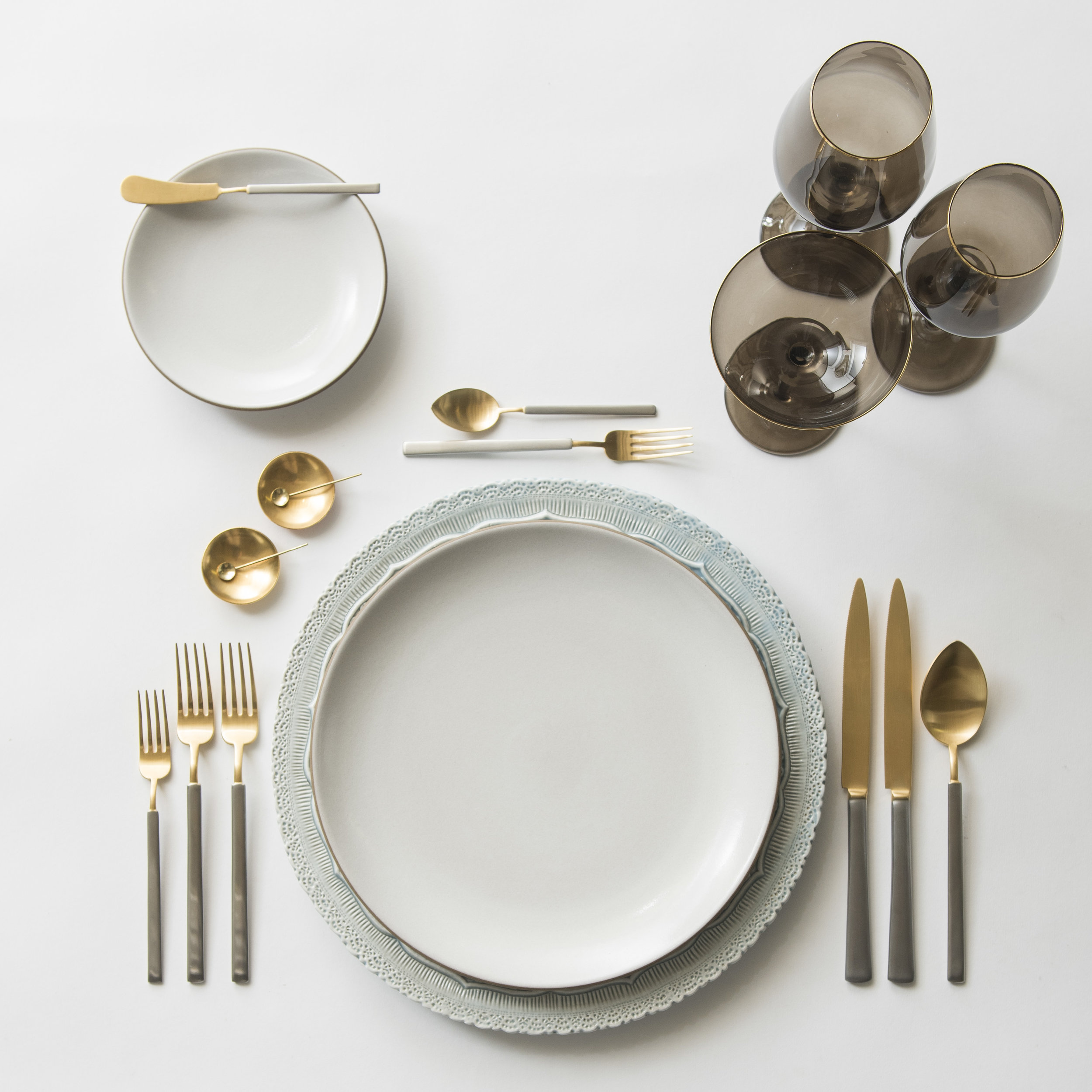 RENT: Lace Chargers in Dusty Blue + Heath Ceramics in Opaque White + Axel Flatware in Matte 24k Gold/Silver + Bella 24k Gold Rimmed Stemware in Smoke + 14k Gold Salt Cellars + Tiny Gold Spoons   SHOP:  Bella 24k Gold Rimmed Stemware in Smoke + 14k Gold Salt Cellars + Tiny Gold Spoons