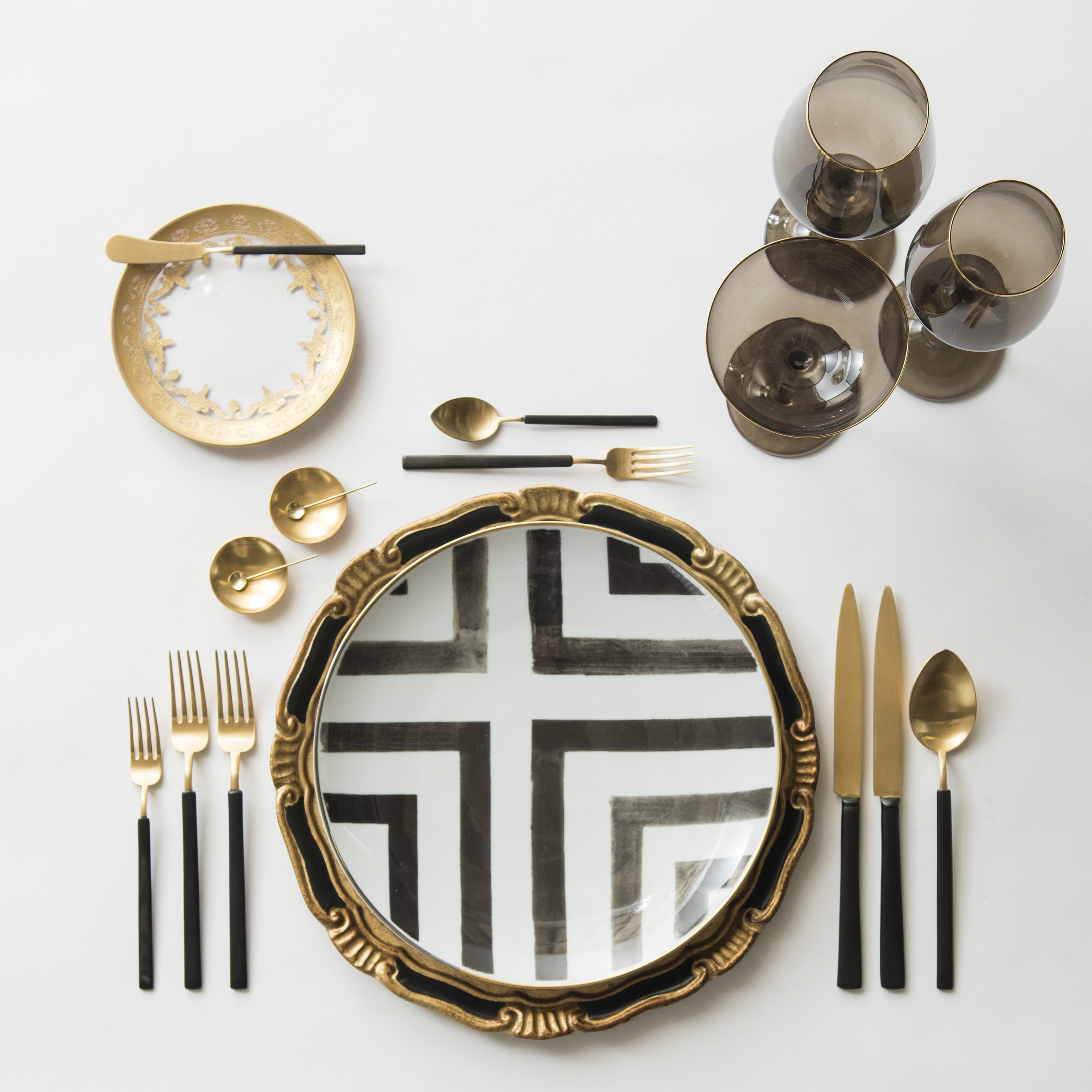 RENT: Florentine Chargers in Black/Gold + Christian Lacroix Sol Y Sombra Dinnerware + Versailles Glass Dinnerware in 24k Gold + Axel Flatware in Matte 24k Gold/Black + Bella 24k Gold Rimmed Stemware in Smoke + 14k Gold Salt Cellars + Tiny Gold Spoons   SHOP:  Bella 24k Gold Rimmed Stemware in Smoke + 14k Gold Salt Cellars + Tiny Gold Spoons