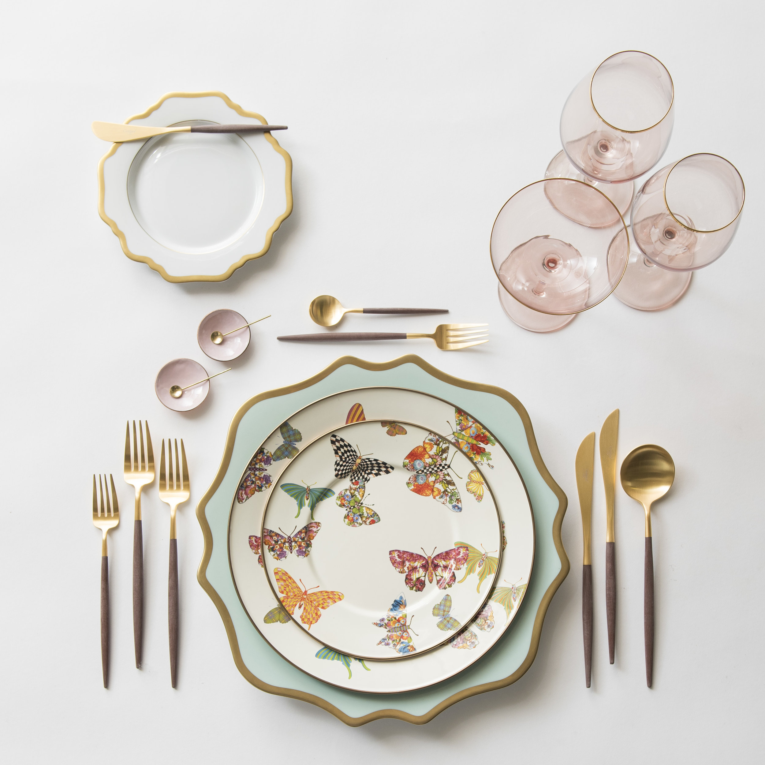 RENT: Anna Weatherley Chargers in Aqua Sky/Gold + MacKenzie-Childs Butterfly Garden Collection + Anna Weatherley Dinnerware in White/Gold + Goa Flatware in Brushed 24k Gold/Wood + Bella 24k Gold Rimmed Stemware in Blush + Pink Enamel Salt Cellars + Tiny Gold Spoons   SHOP: Anna Weatherley Chargers in Aqua Sky/Gold + Anna Weatherley Dinnerware in White/Gold + Goa Flatware in Brushed 24k Gold/Wood + Bella 24k Gold Rimmed Stemware in Blush + Pink Enamel Salt Cellars + Tiny Gold Spoons