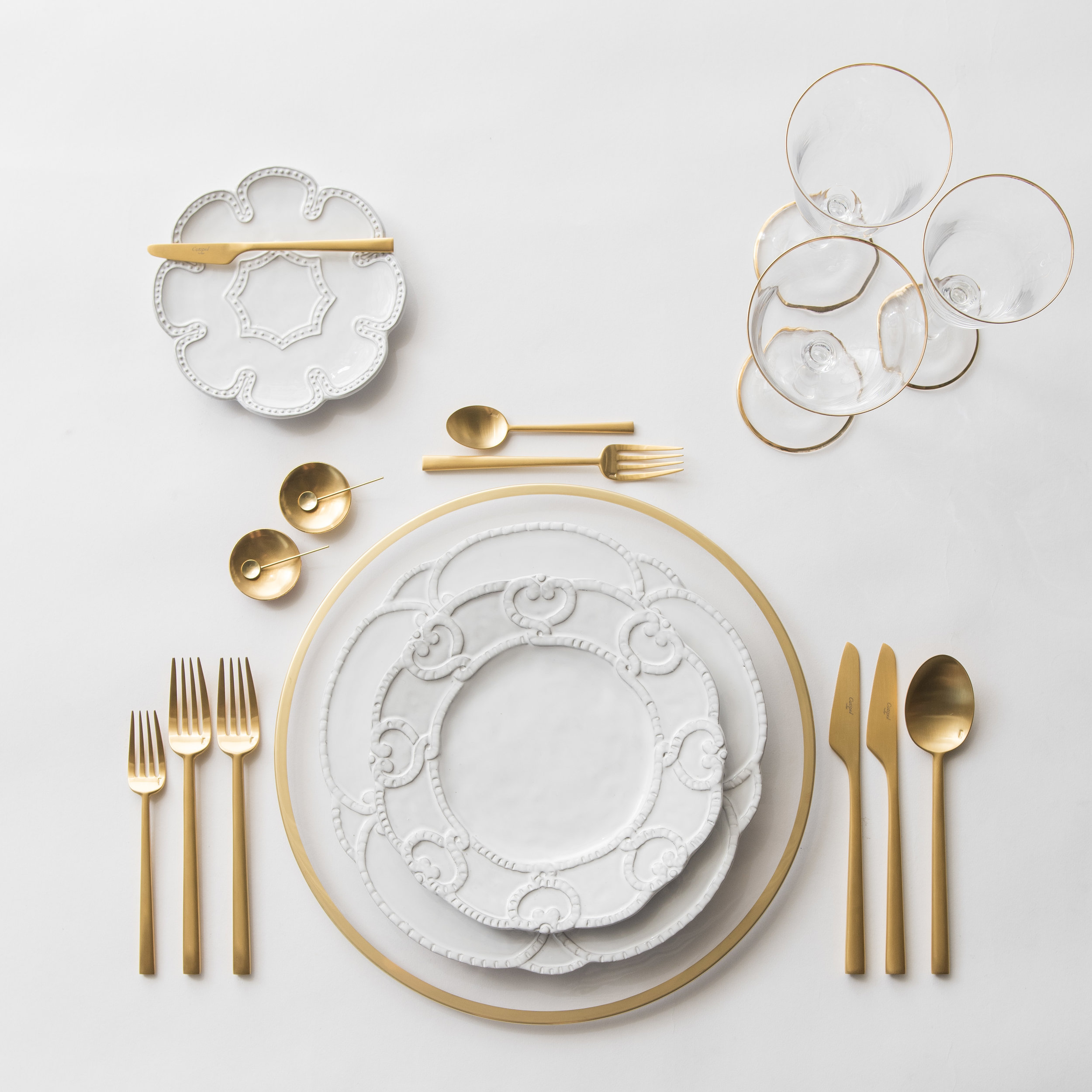 RENT: Halo Glass Chargers in 24k Gold + Signature Collection Dinnerware + Rondo Flatware in Brushed 24k Gold + Chloe 24k Gold Rimmed Stemware + 14k Gold Salt Cellars + Tiny Gold Spoons  SHOP: Halo Glass Chargers in 24k Gold + Rondo Flatware in Brushed 24k Gold + Chloe 24k Gold Rimmed Stemware + 14k Gold Salt Cellars + Tiny Gold Spoons