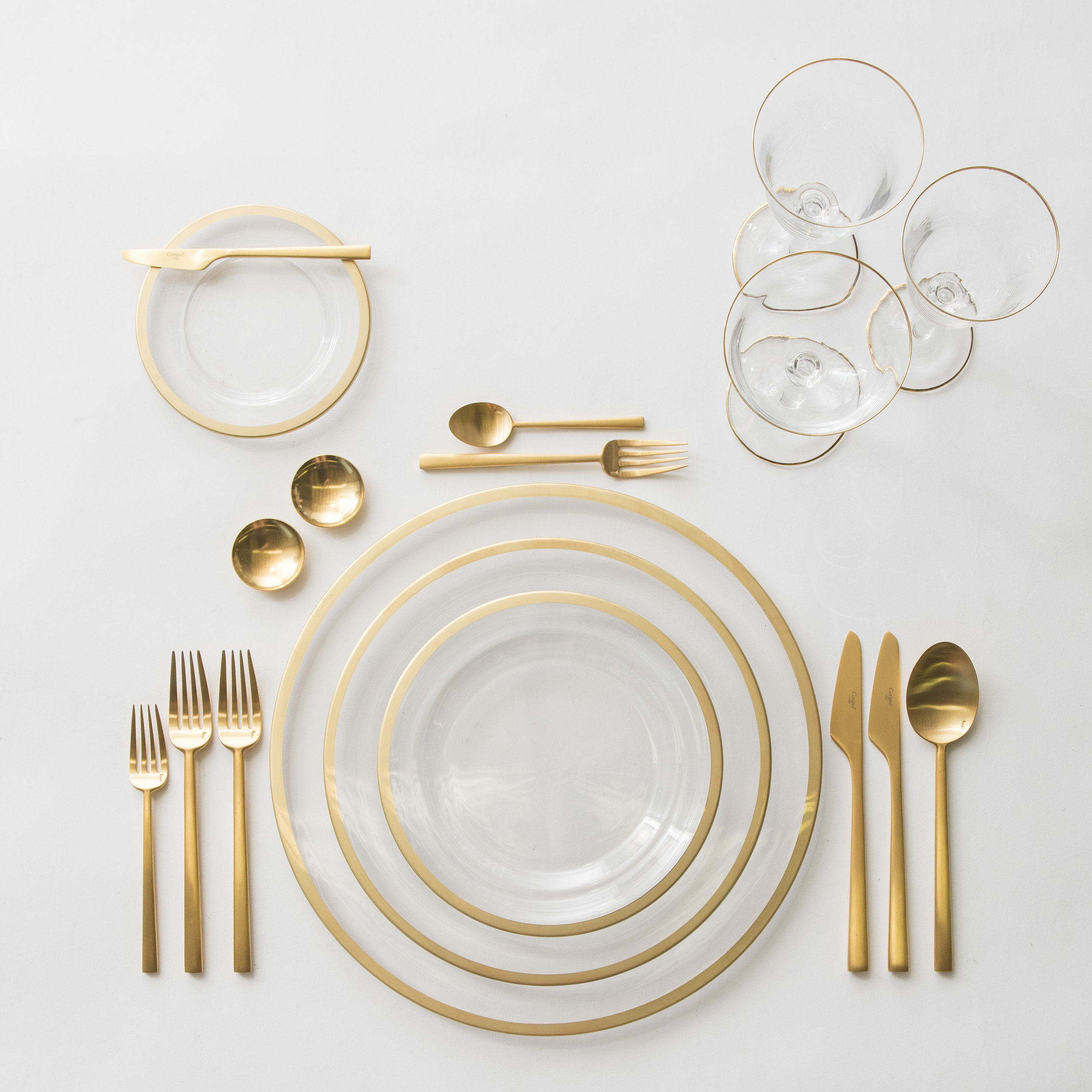RENT: Halo Glass Chargers/Dinnerware in 24k Gold + Rondo Flatware in Brushed 24k Gold + Chloe 24k Gold Rimmed Stemware + 14k Gold Salt Cellars + Tiny Gold Spoons  SHOP: Halo Glass Chargers/Dinnerware in 24k Gold + Rondo Flatware in Brushed 24k Gold + Chloe 24k Gold Rimmed Stemware + 14k Gold Salt Cellars + Tiny Gold Spoons