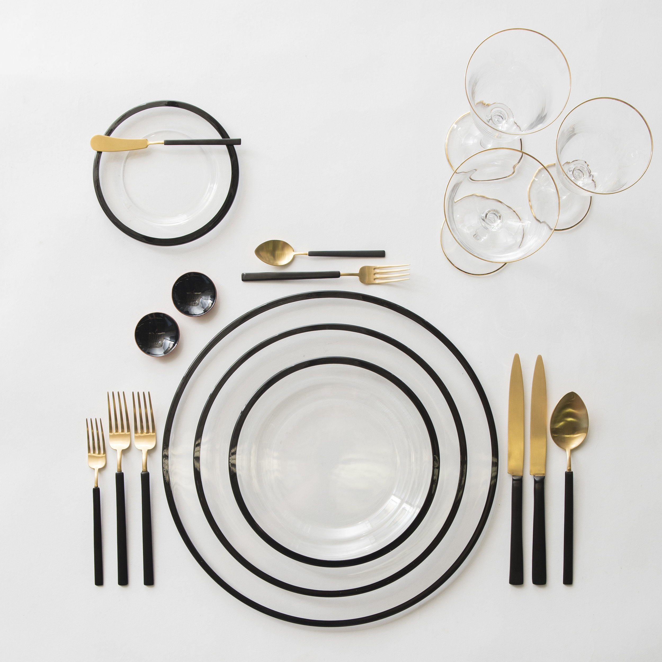 RENT: Halo Glass Chargers/Dinnerware in Black + Axel Flatware in Matte 24k Gold/Black + Chloe 24k Gold Rimmed Stemware + Black Enamel Salt Cellars + Tiny Gold Spoons  SHOP: Halo Glass Chargers/Dinnerware in Black + Chloe 24k Gold Rimmed Stemware + Black Enamel Salt Cellars + Tiny Gold Spoons