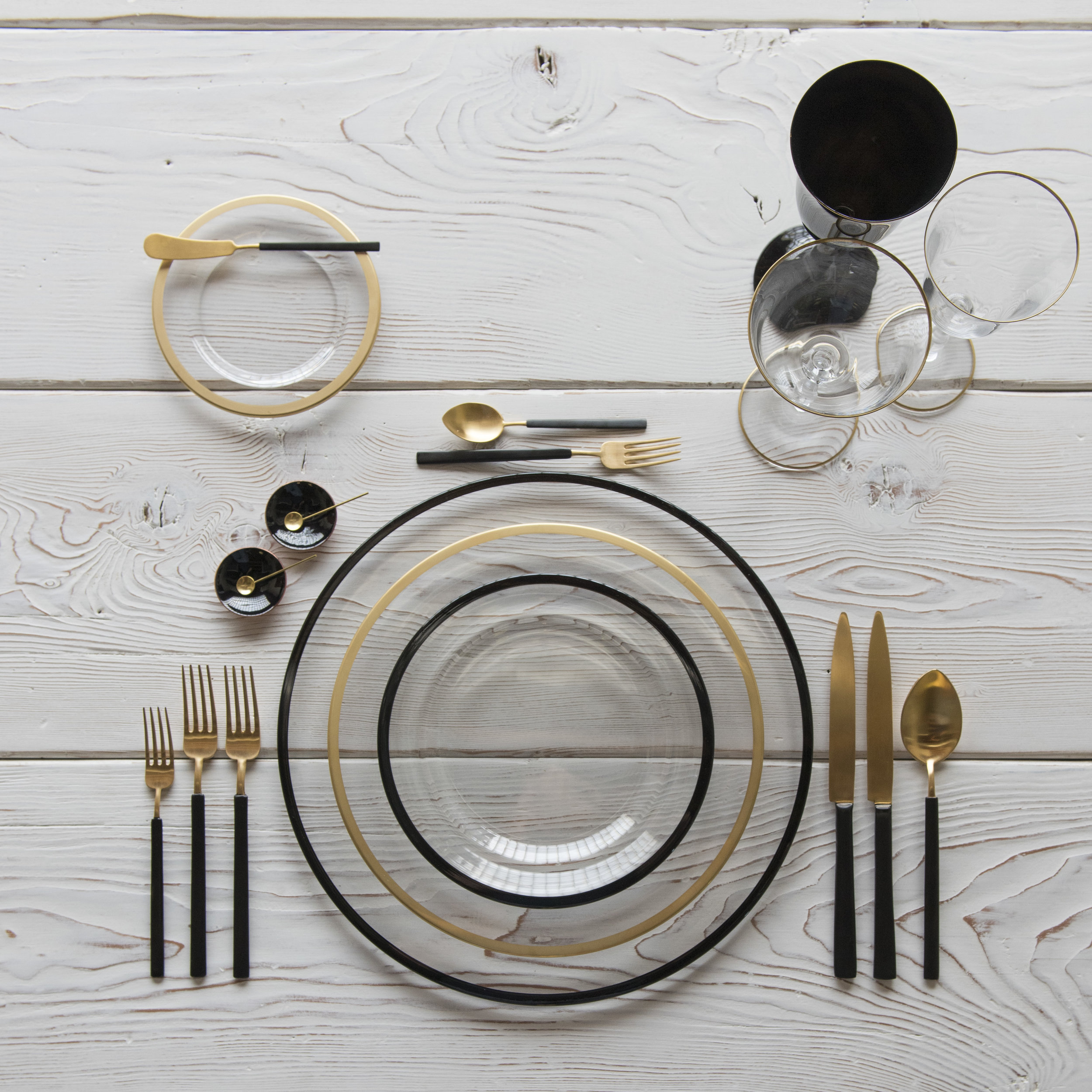 RENT: Halo Glass Chargers/Dinnerware in Black + Halo Glass Dinnerware in 24k Gold + Axel Flatware in Matte 24k Gold/Black + Chloe 24k Gold Rimmed Stemware + Chloe 24k Gold Rimmed Goblet it Black + Black Enamel Salt Cellars + Tiny Gold Spoons  SHOP: Halo Glass Chargers/Dinnerware in Black + Halo Glass Dinnerware in 24k Gold + Chloe 24k Gold Rimmed Stemware + Black Enamel Salt Cellars + Tiny Gold Spoons