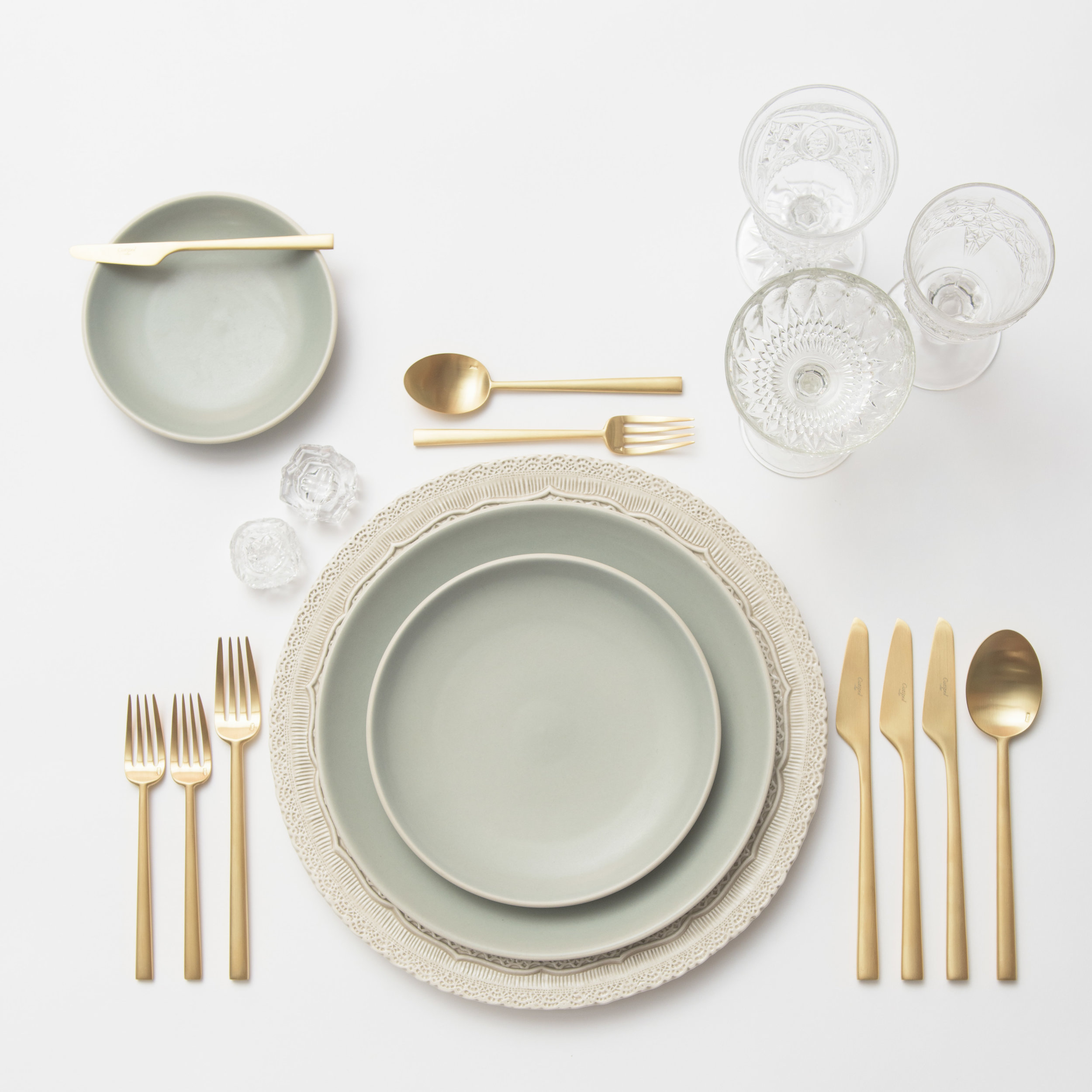 RENT: Lace Chargers in White + Heath Ceramics in Mist + Rondo Flatware in Brushed 24k Gold + Early American Pressed Glass Goblets + Antique Crystal Salt Cellars  SHOP: Rondo Flatware in Brushed 24k Gold